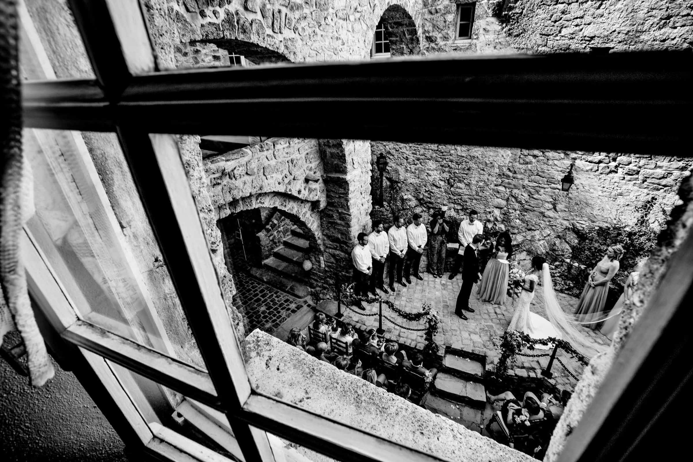 Window view of a gorgeous Chateau Zen wedding ceremony in the south of France near Montepelier.