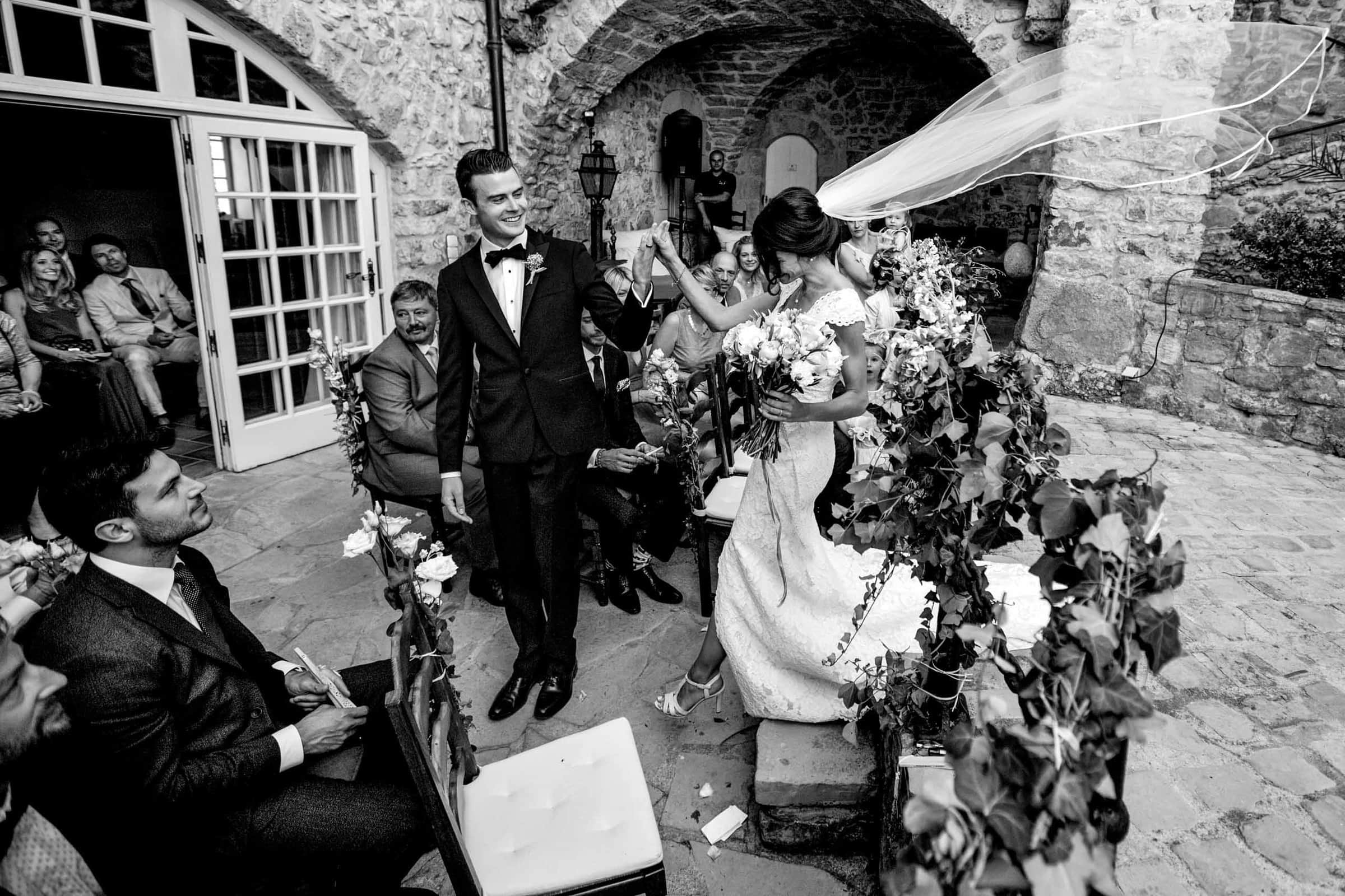 Bride and groom exiting a gorgeous Chateau Zen wedding ceremony in the south of France near Montepelier.