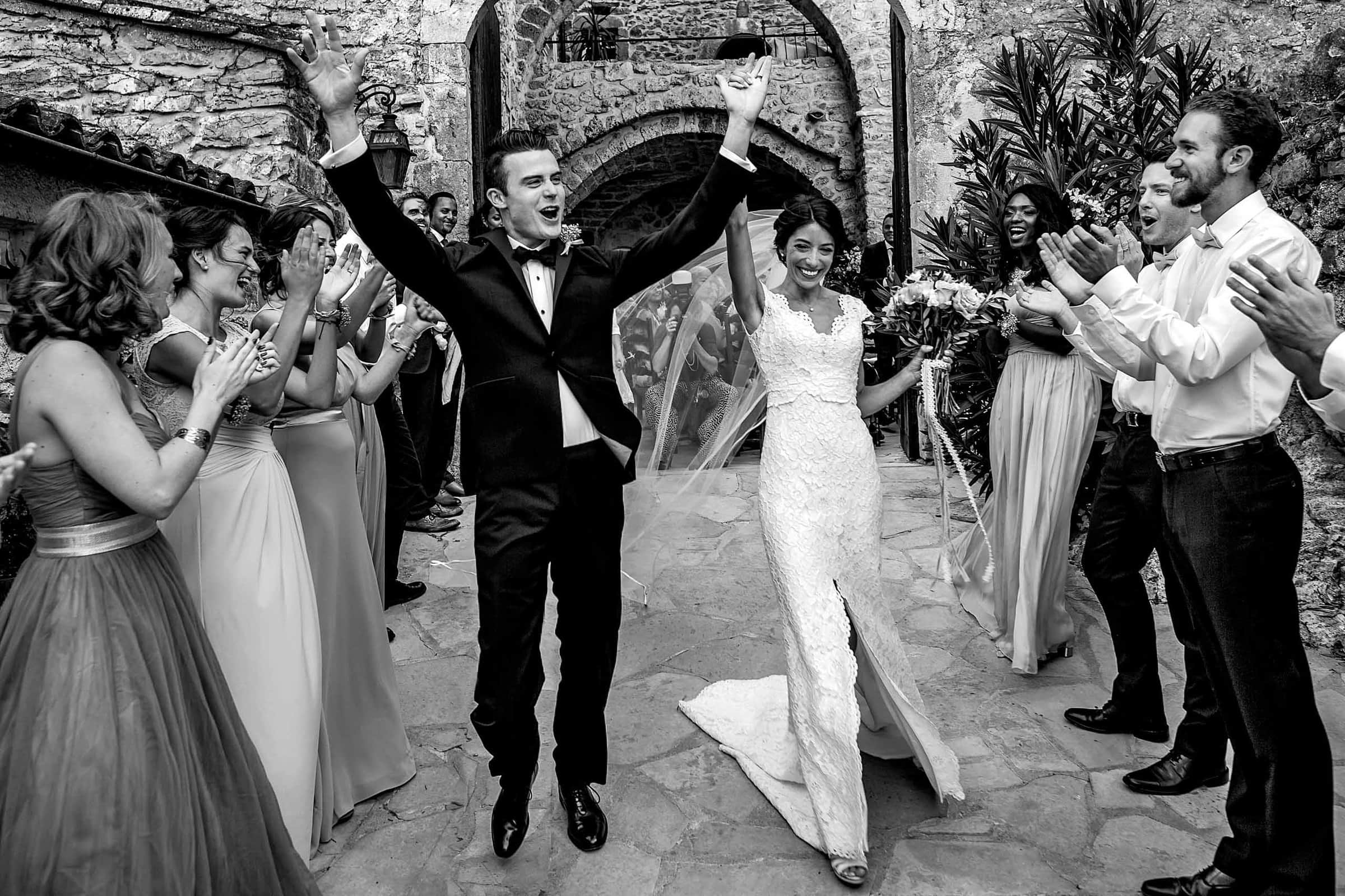 Ecstatic exit with the bride and groom during a gorgeous Chateau Zen wedding ceremony in the south of france