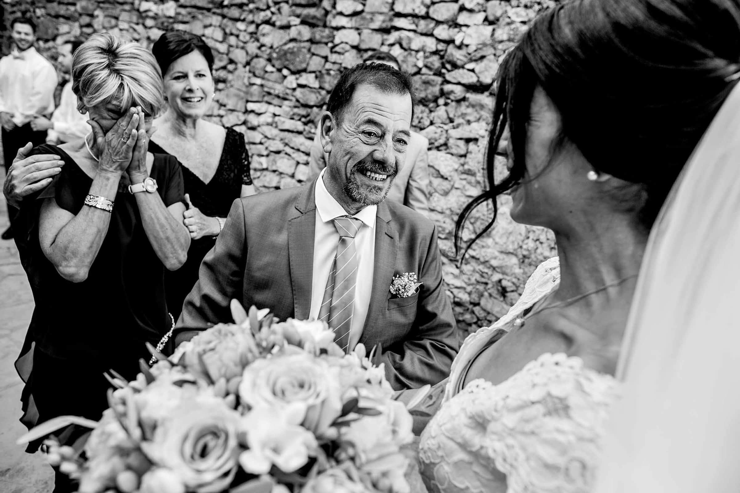Emotional photo of parents with a bride during a Chateau Zen wedding in the south of France near Montpelier.