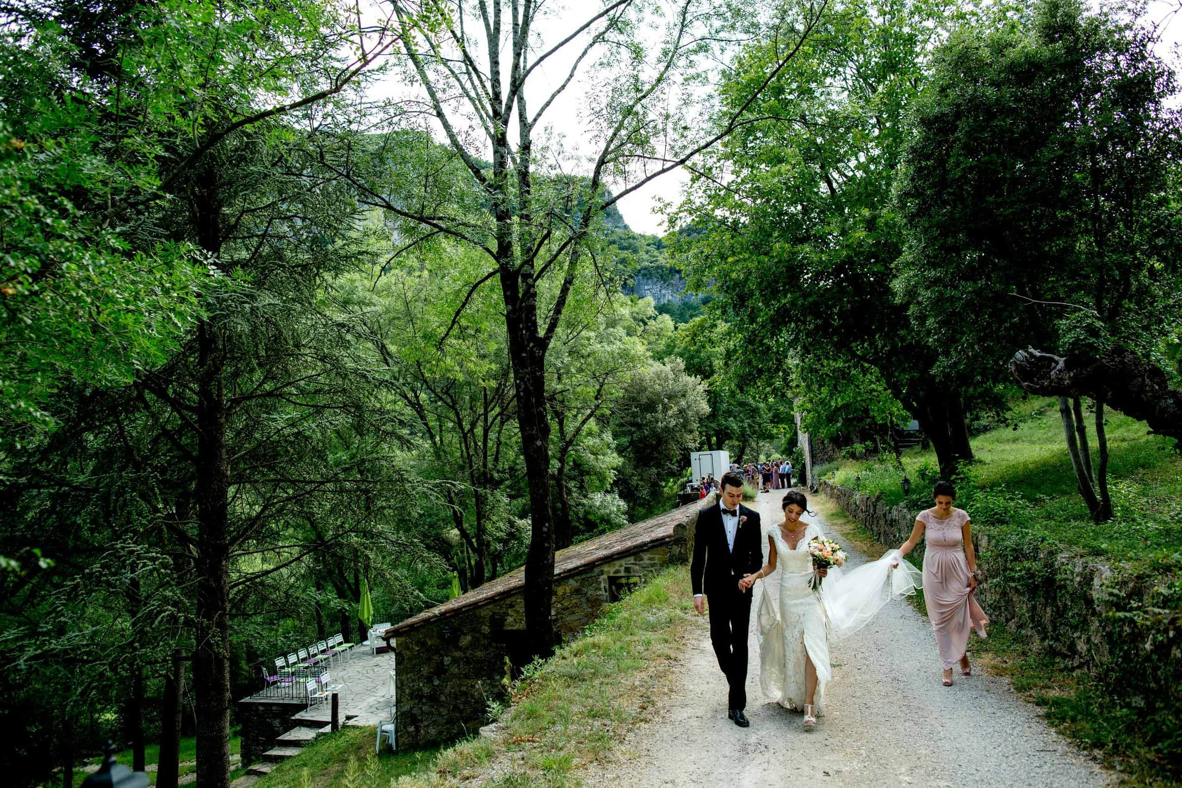 Bride and groom walking through the forest moments after their Chateau Zen wedding in the South of France near Montepelier.