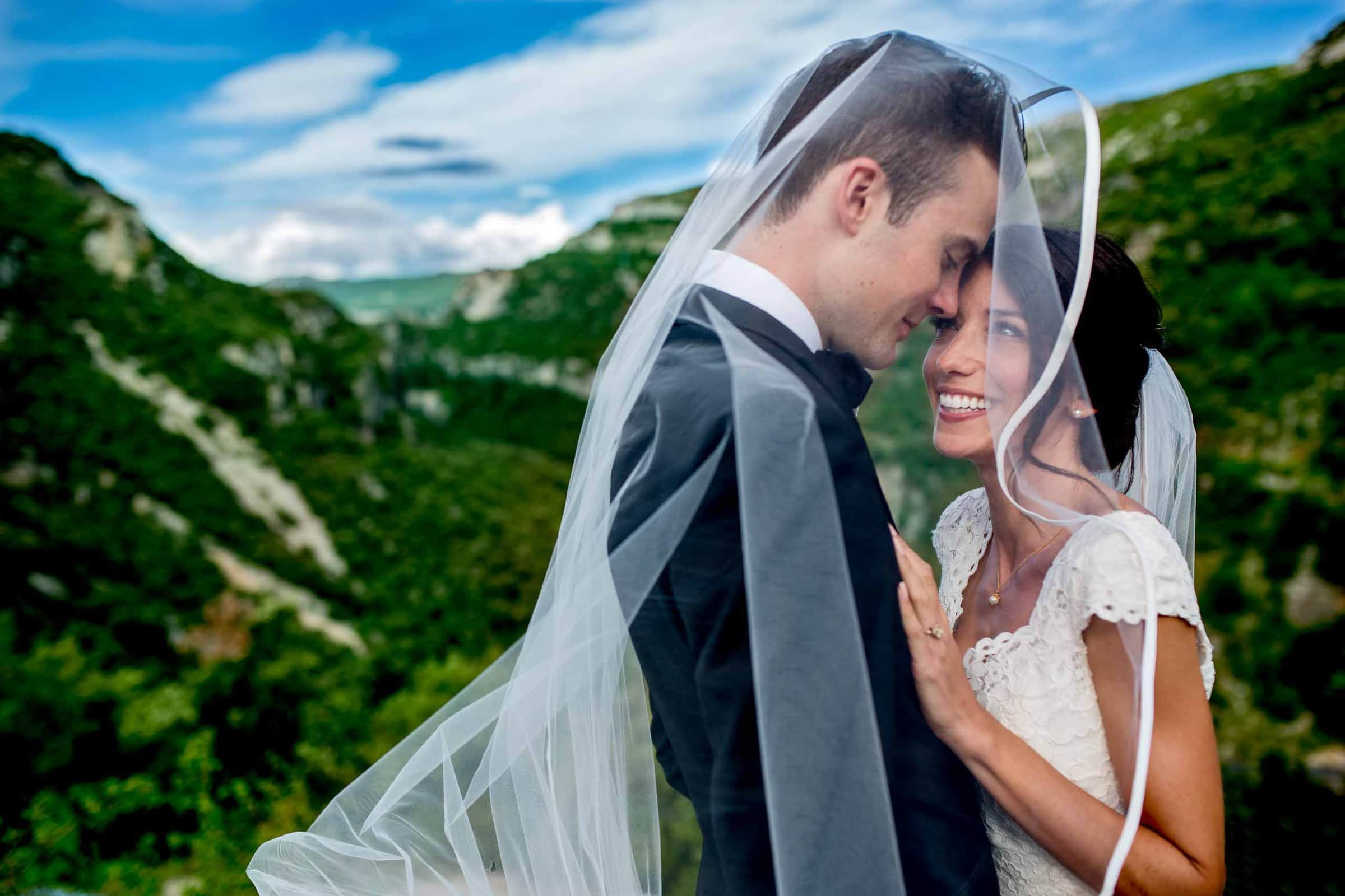 Happy bride and groom photo in the mountains following their Chateau Zen wedding in the South of France near Montepelier.