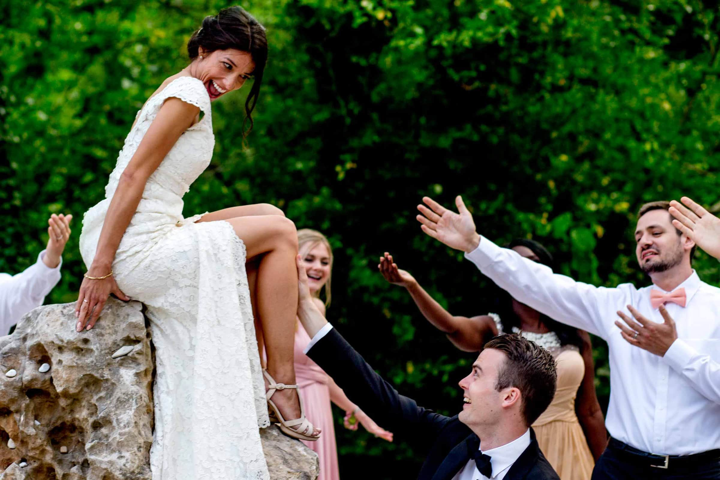 Happy bride with friends in Cirque de Navacelles valley during their Chateau Zen wedding in the South of France near Montepelier.