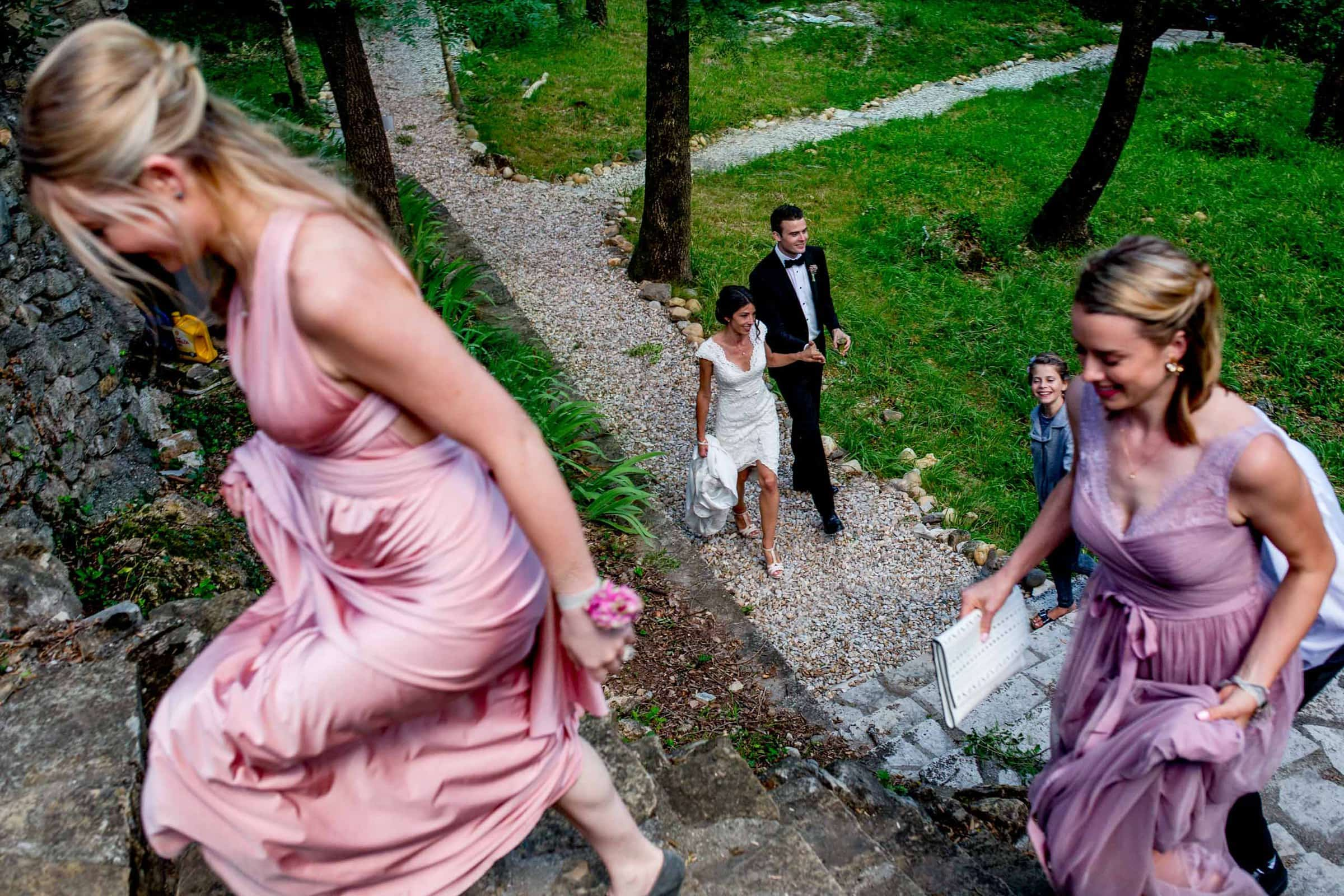 Friends walking with bride and groom in Cirque de Navacelles valley during their Chateau Zen wedding in the South of France near Montepelier.