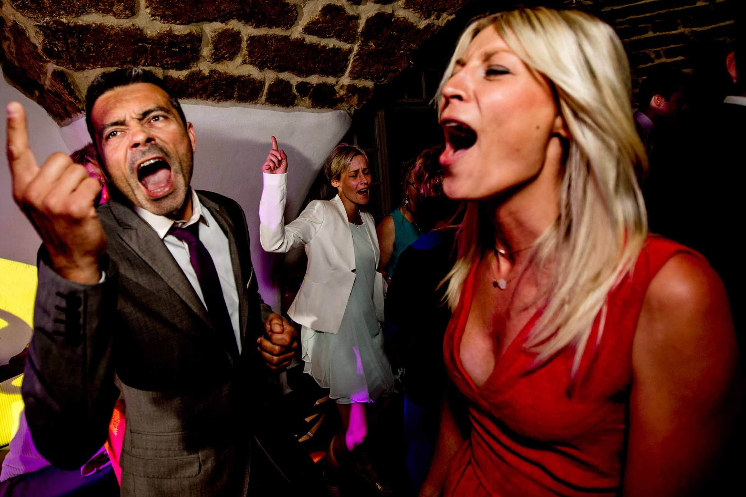 Happy guests partying late into the night at a Chateau Zen wedding in the South of France near Montepelier.