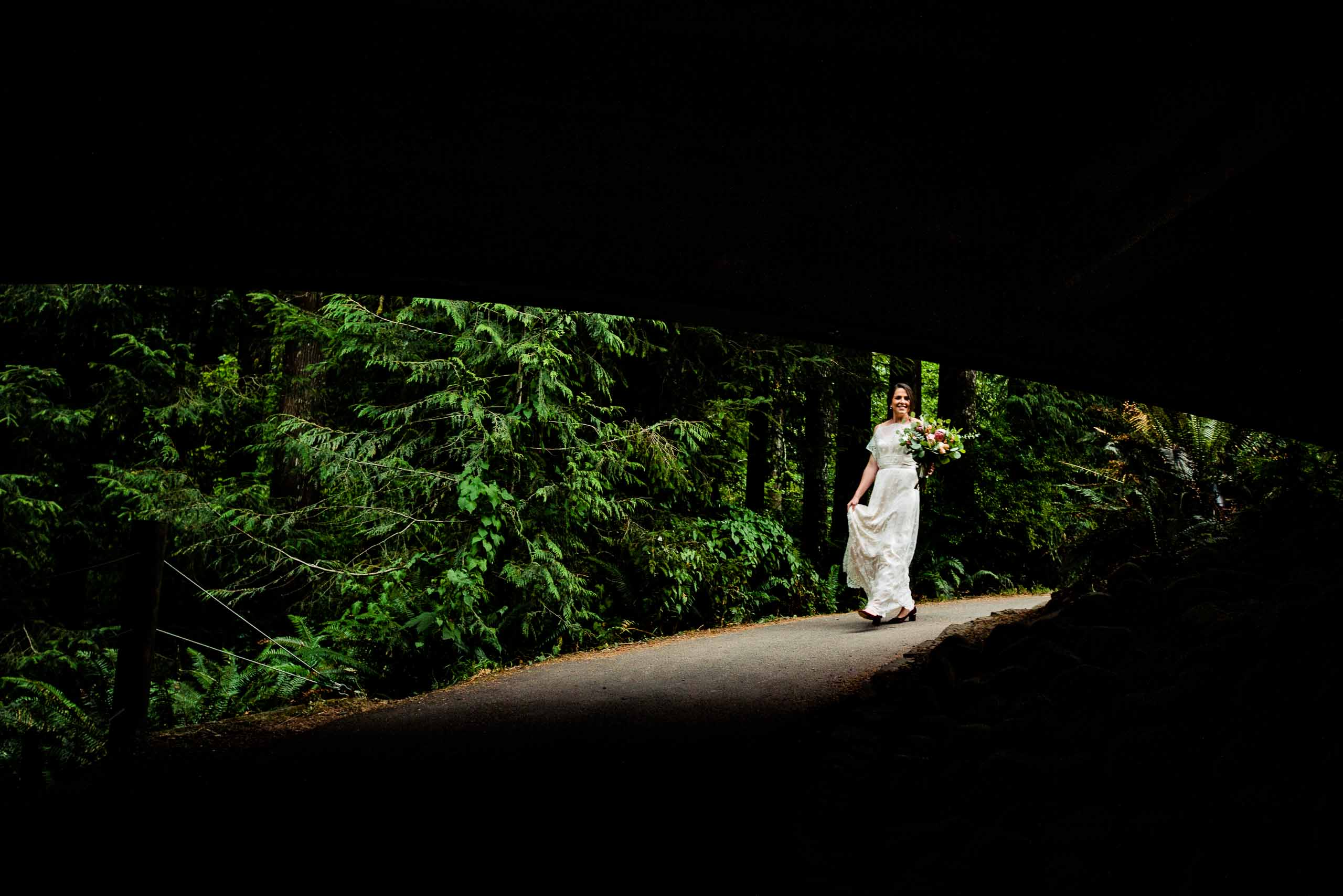 Bride walking down to the ocean for her Oregon Coast Elopement