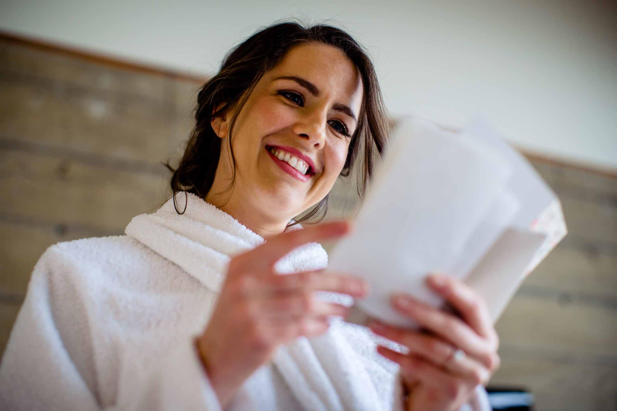 Bride reading a note from her groom just before her Oregon Coast Elopement