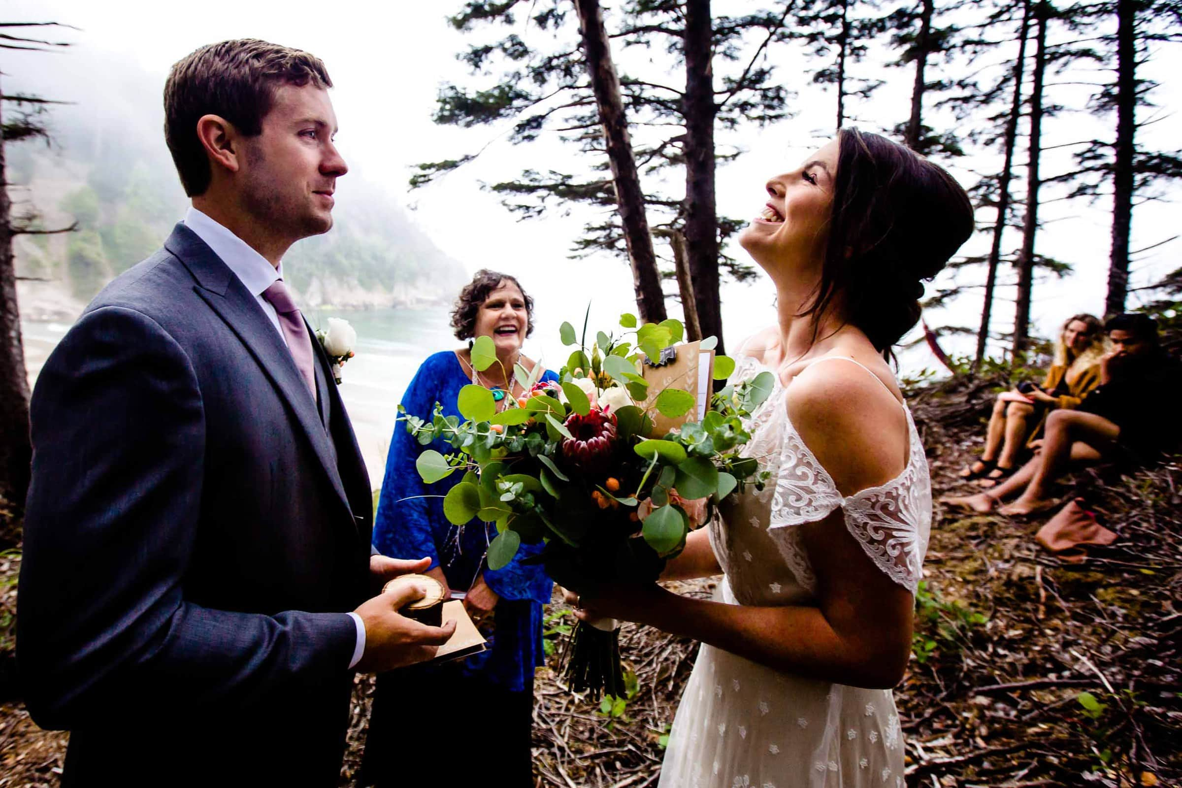 Bride and groom exchanging vows during their Oregon Coast Elopement ceremony