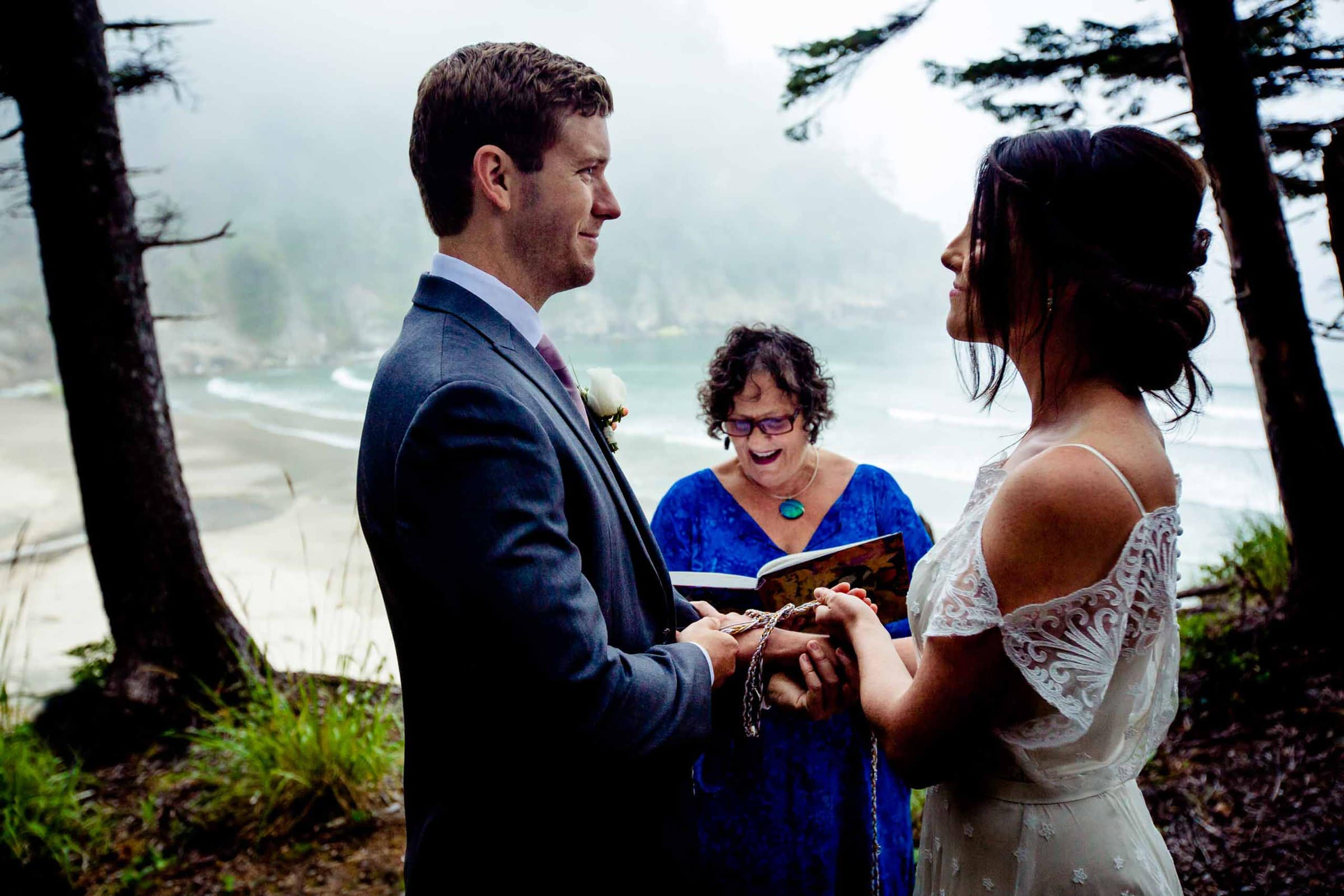 Bride and groom exchanging rings during their Oregon Coast Elopement ceremony