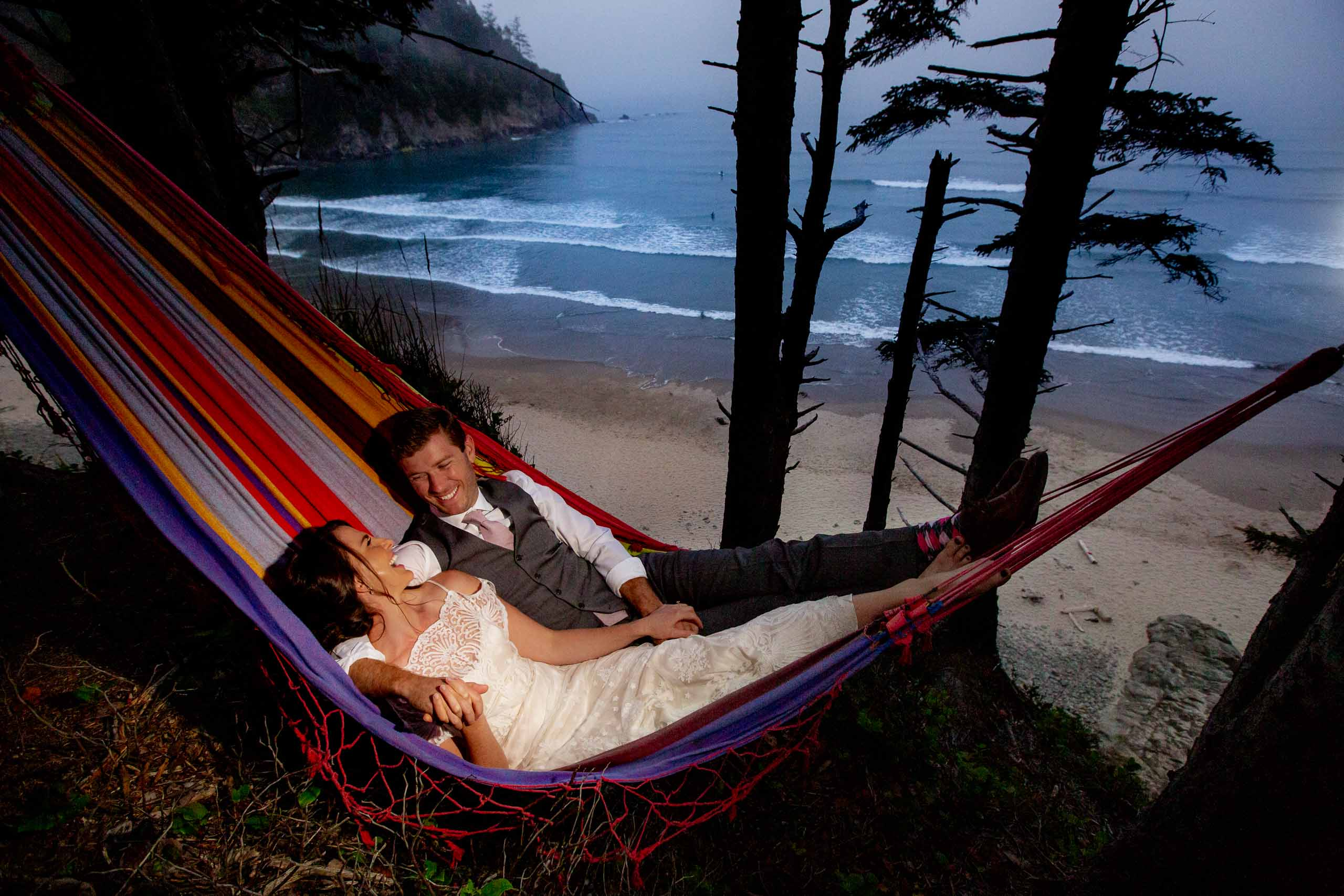Bride and groom in a hammock near the ocean during their Oregon Coast Elopement