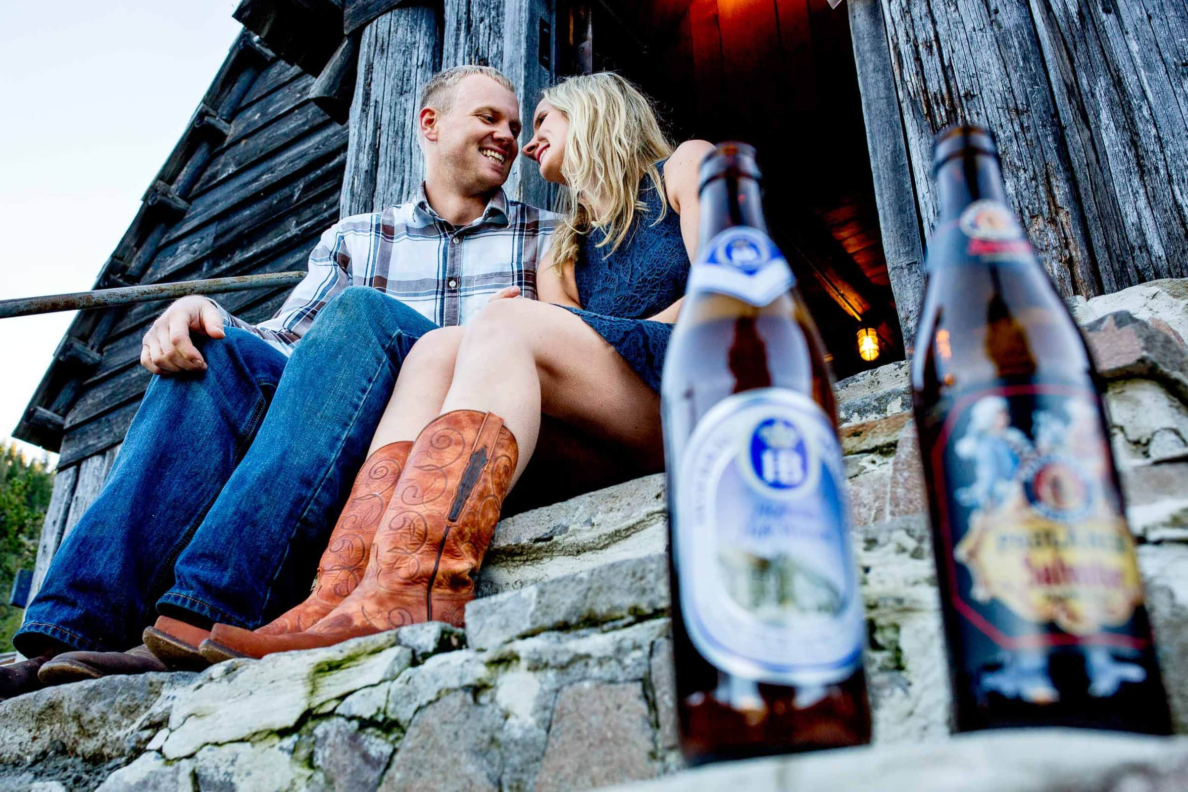 Two beers and a couple in love at a warming hut for their Mt Hood engagement photos