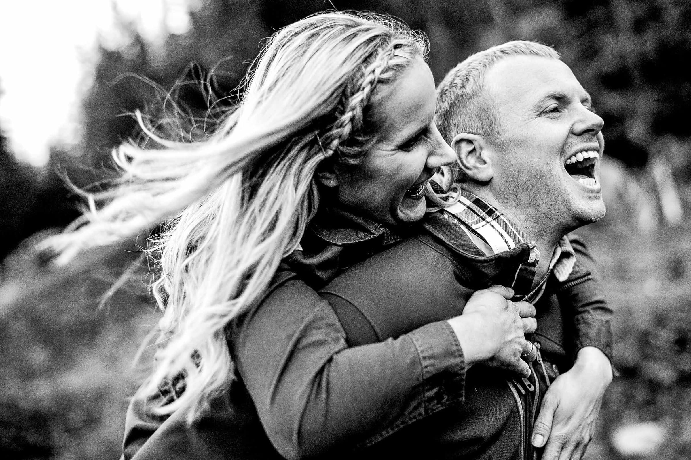 A couple running and laughing during their Mt Hood engagement photos at Ski Bowl.
