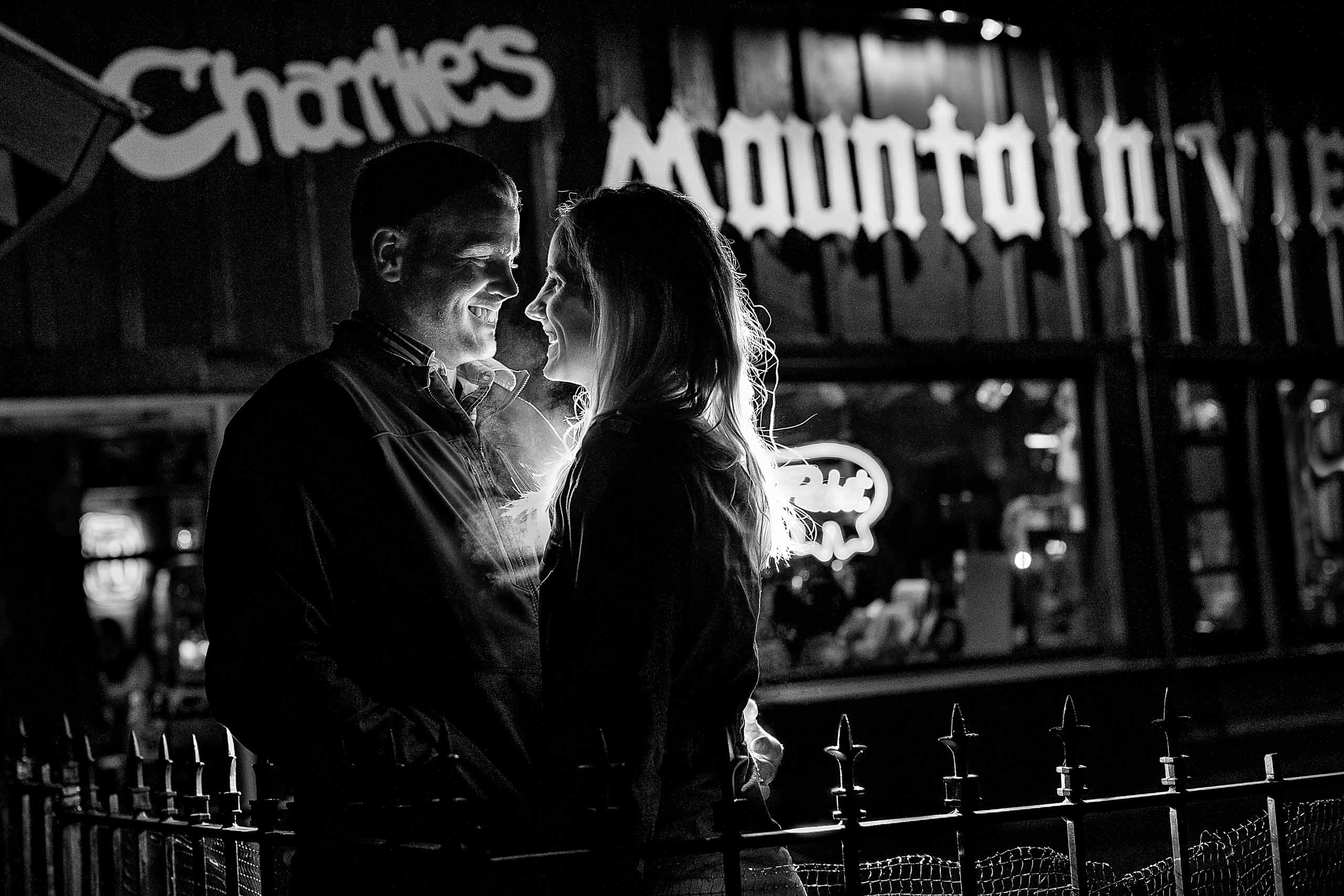A fun back lit photo of a couple at Charlie's Mountain restaurant for their Mt Hood engagement photos
