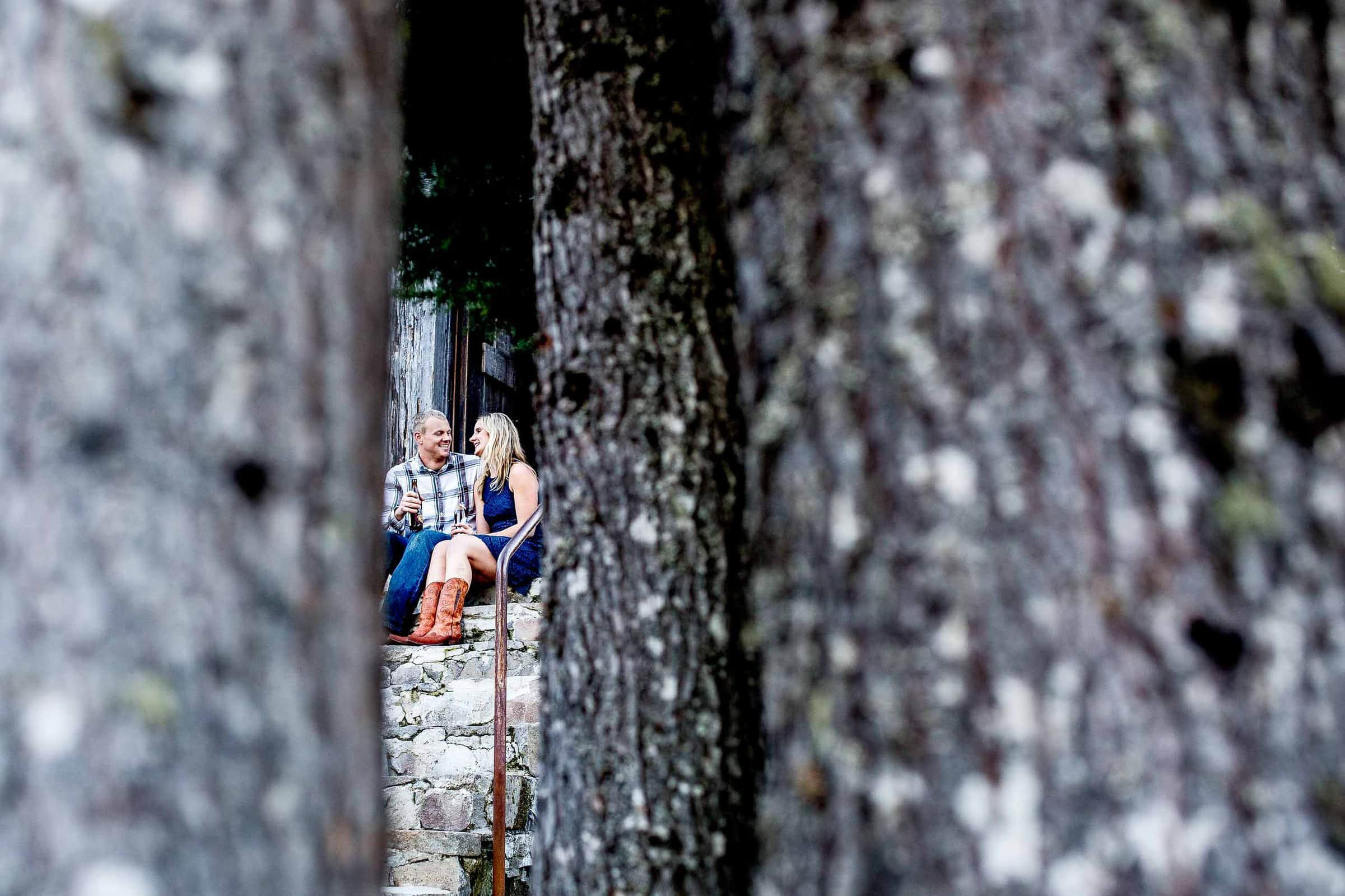 An intimate view through trees on a couple for their Mt Hood engagement photos