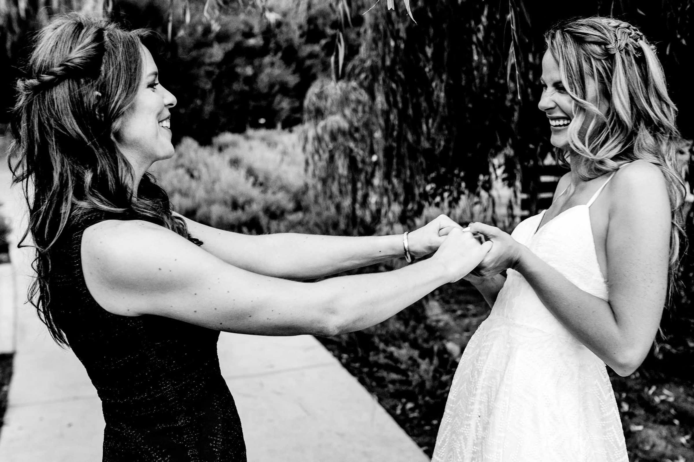 Two happy brides embracing their love moments after their Calamigos Ranch wedding ceremony