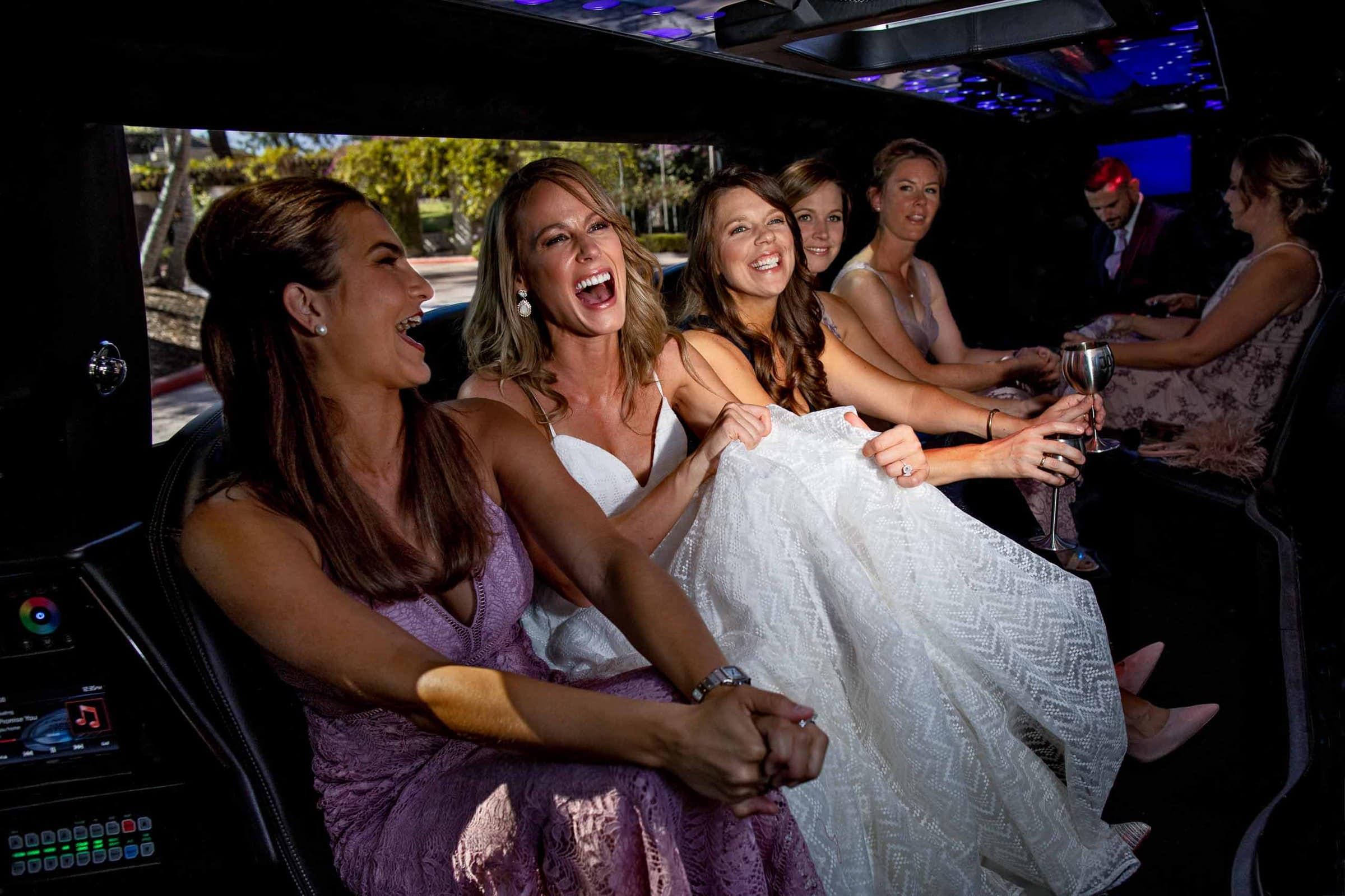Bride and Bride riding with best friends in a limo to their Calamigos Ranch Wedding in Malibu, California