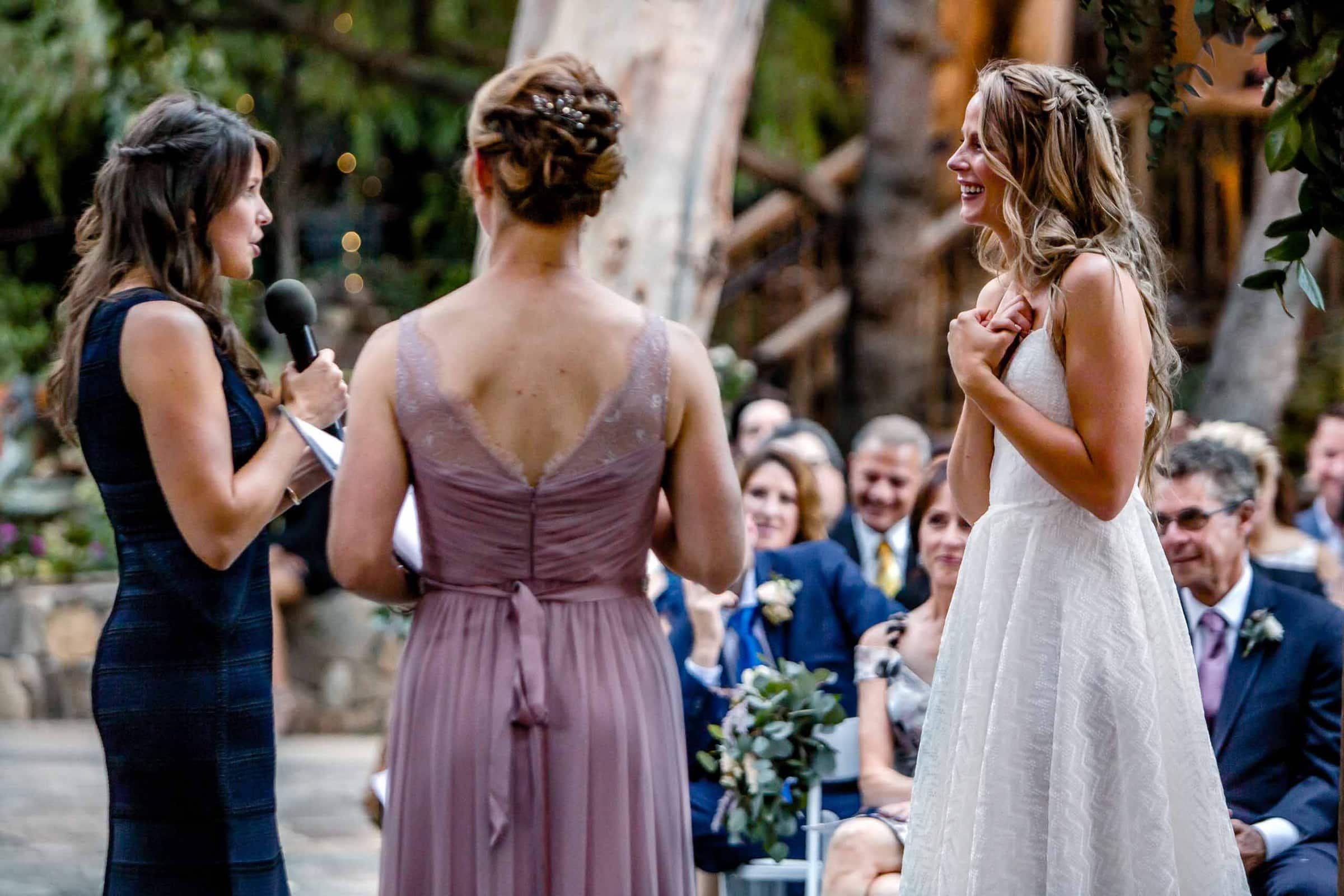 Two brides speaking their hearts to each other in their vows during their Calamigos Ranch Wedding ceremony