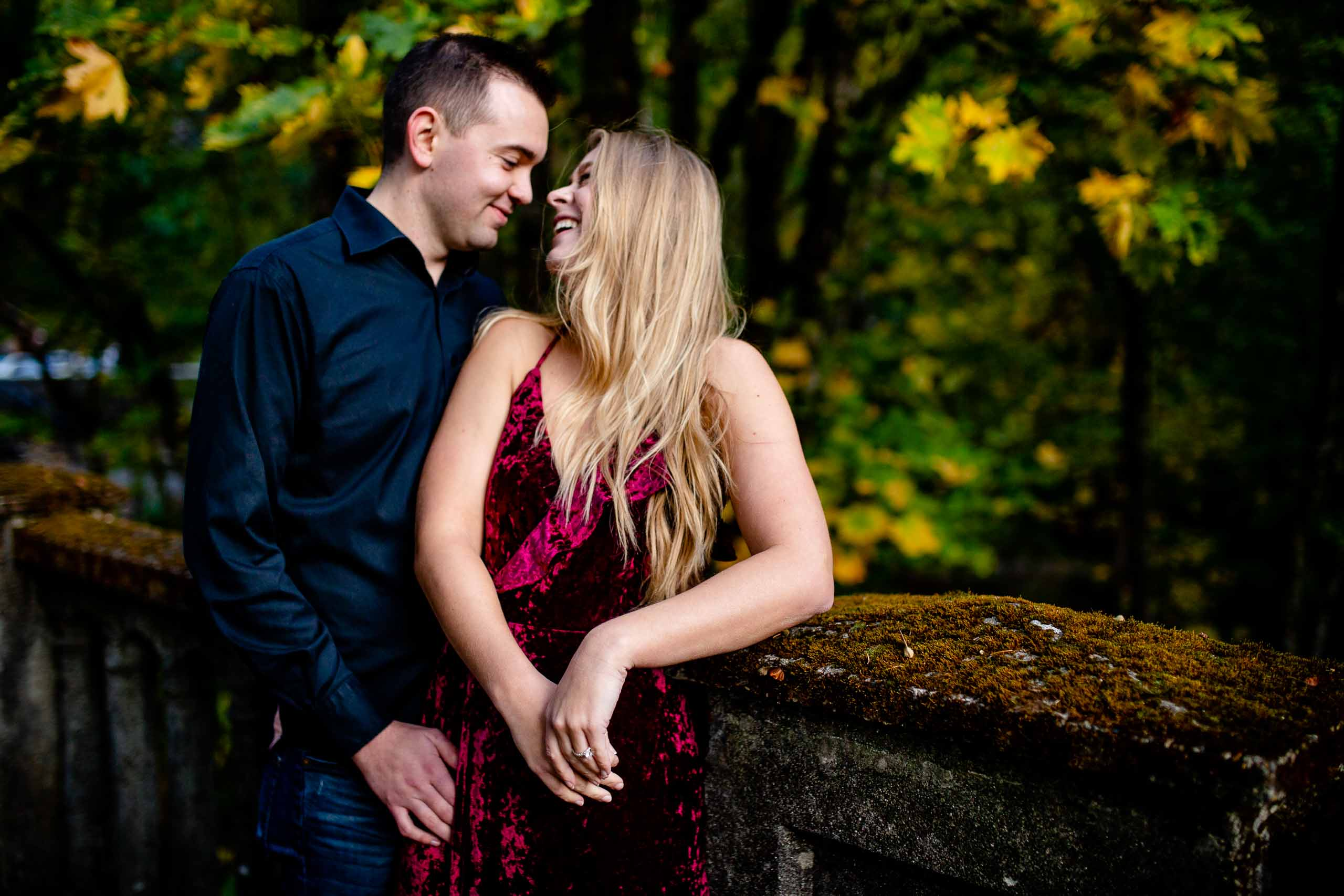 A lovely Columbia Gorge engagement photo of a couple snuggling together just outside Hood River Oregon