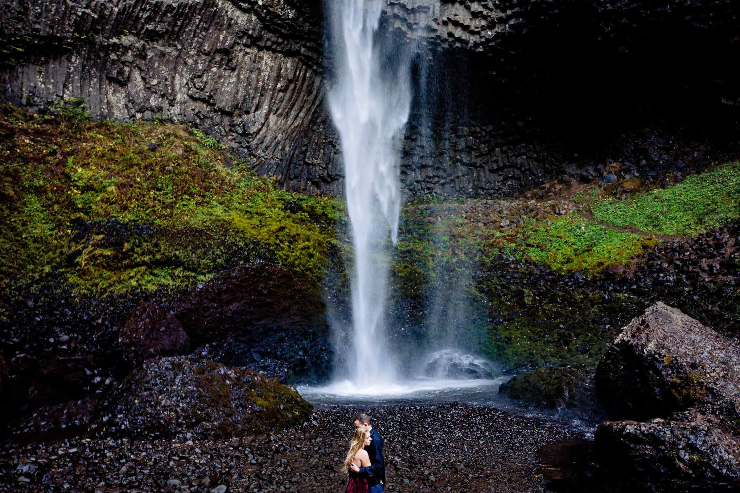 Beautiful Columbia Gorge engagement photo of a couple under a gorgeous waterfall near Hood River Oregon