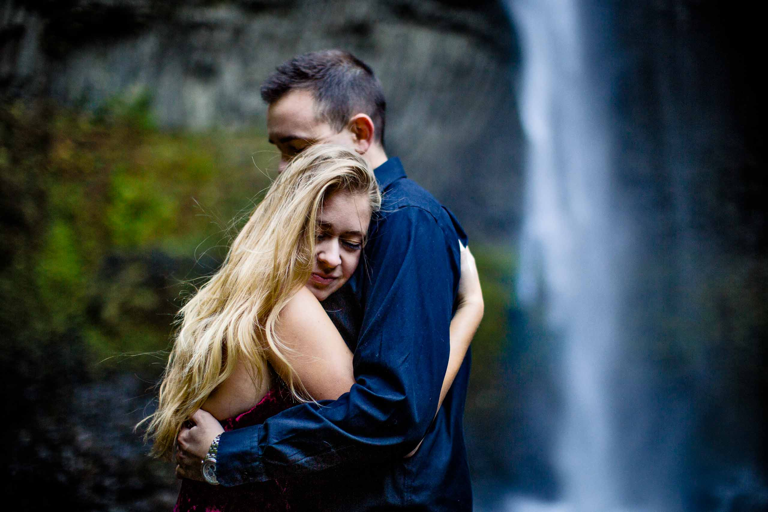 Intimate Columbia Gorge engagement photo of a couple under a beautiful waterfall near Hood River Oregon