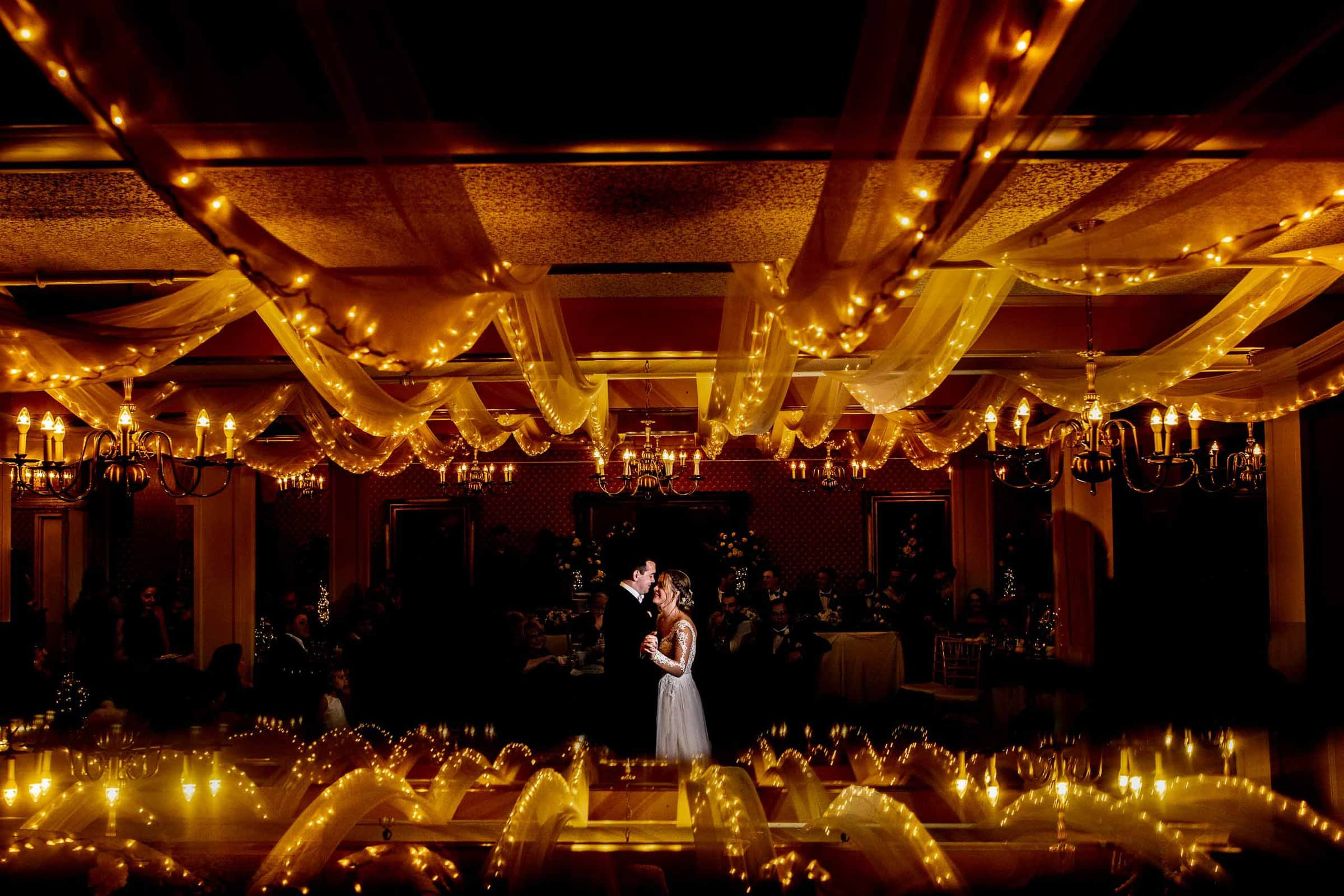 Bride and groom first dance during their Columbia Gorge Hotel wedding in the downstairs ballroom.