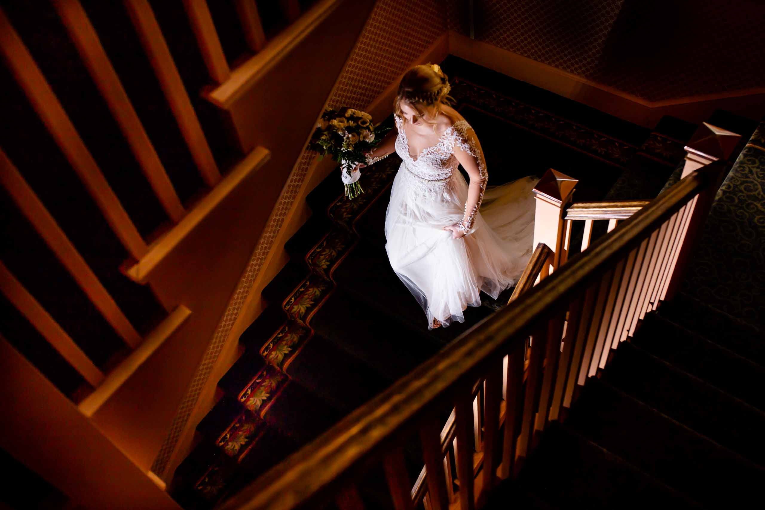 Bride walking down staircase into her Columbia Gorge Wedding ceremony in Hood River, Oregon