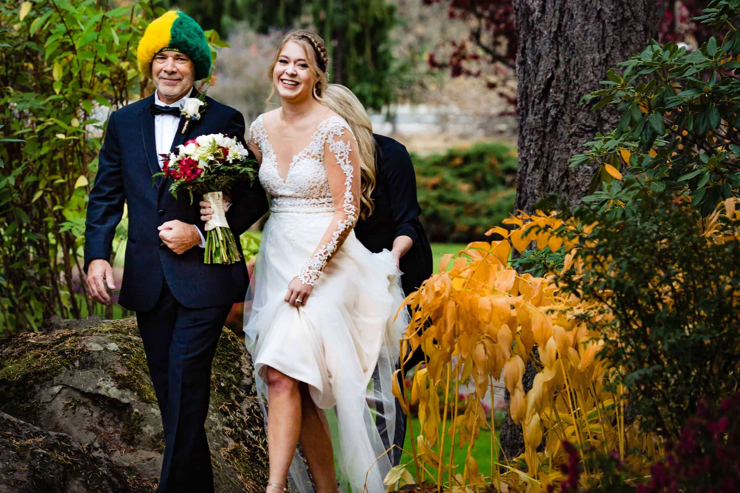 Funny photo of a bride and father with a comical hat while walking into her Columbia Gorge Wedding near Hood River Oregon