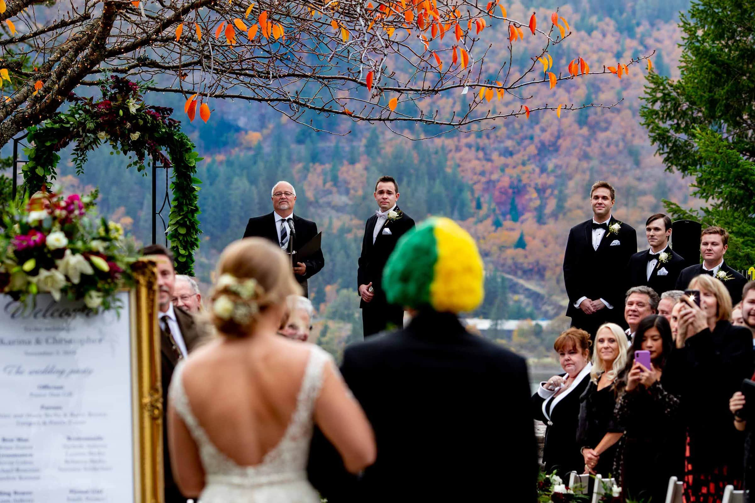 Emotional photo of a groom seeing his bride for the first time during their Columbia Gorge Hotel wedding in Hood River Oregon
