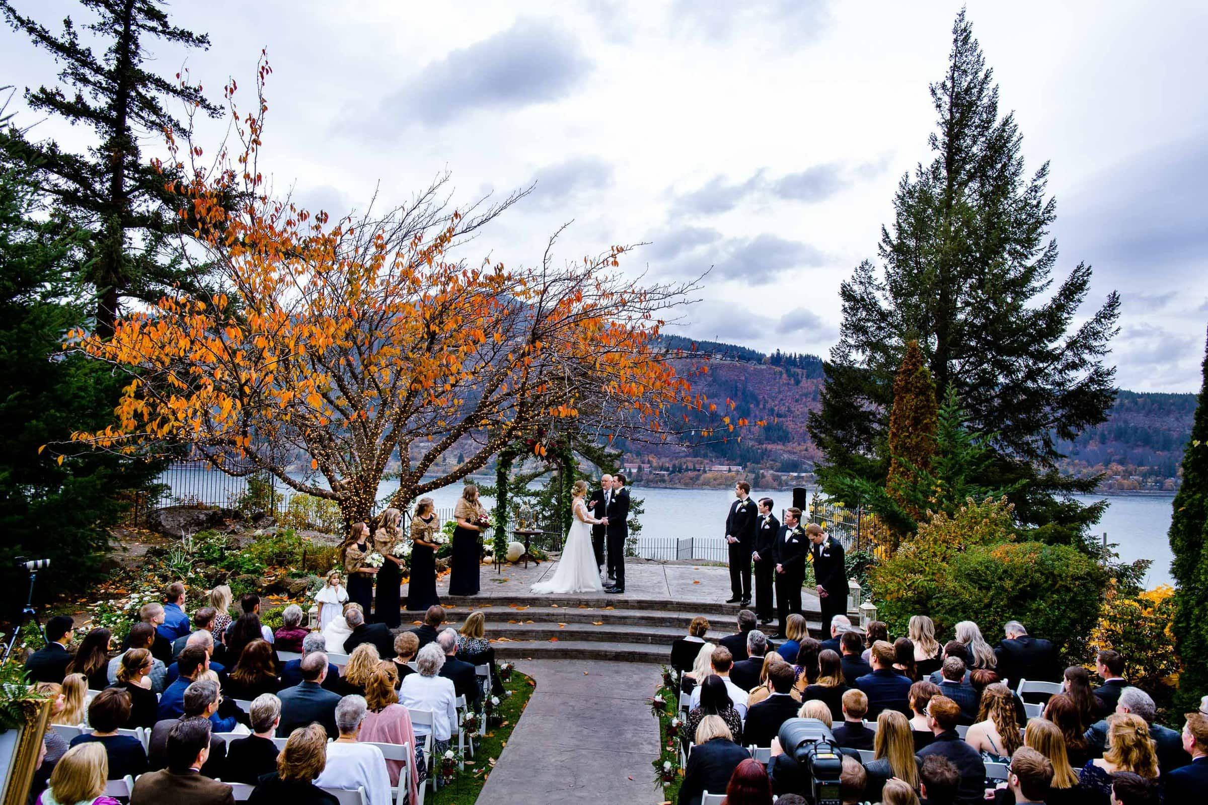 Bride and groom exchanging vows during their Columbia Gorge Hotel wedding ceremony