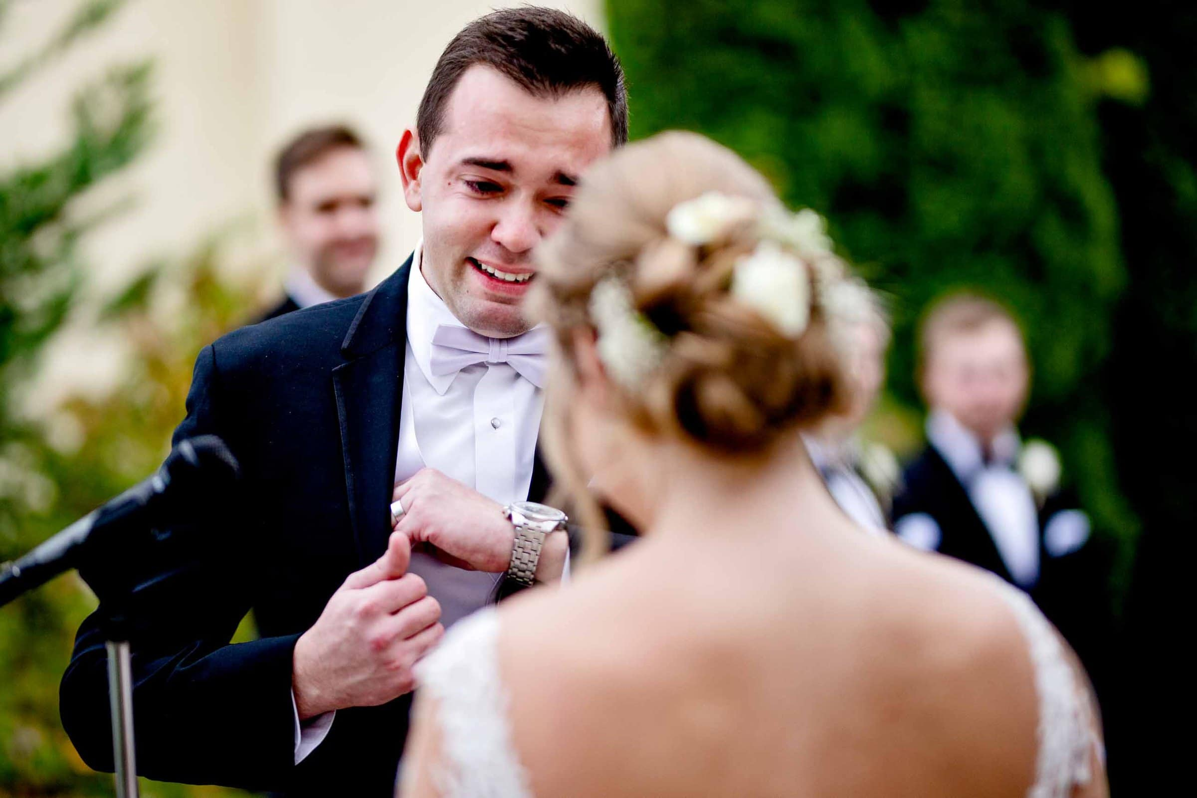 Emotional groom exchanging vows during their Columbia Gorge Hotel wedding ceremony