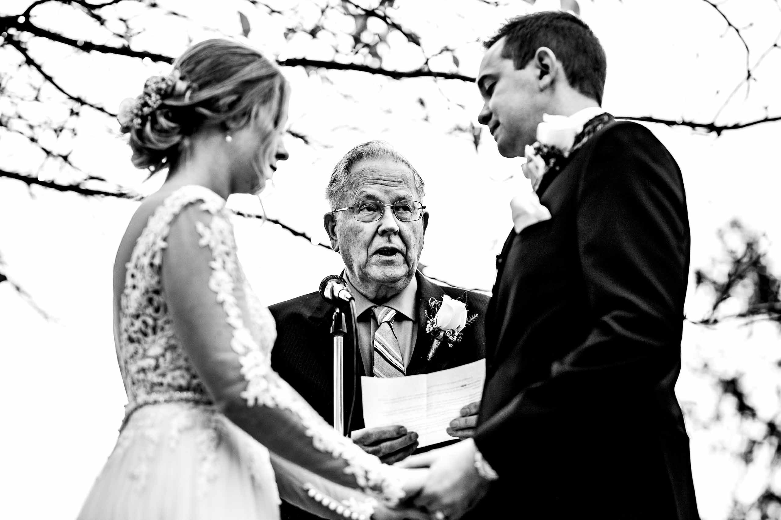 Bride and groom exchanging vows during their Columbia Gorge Wedding Ceremony in Hood River Oregon