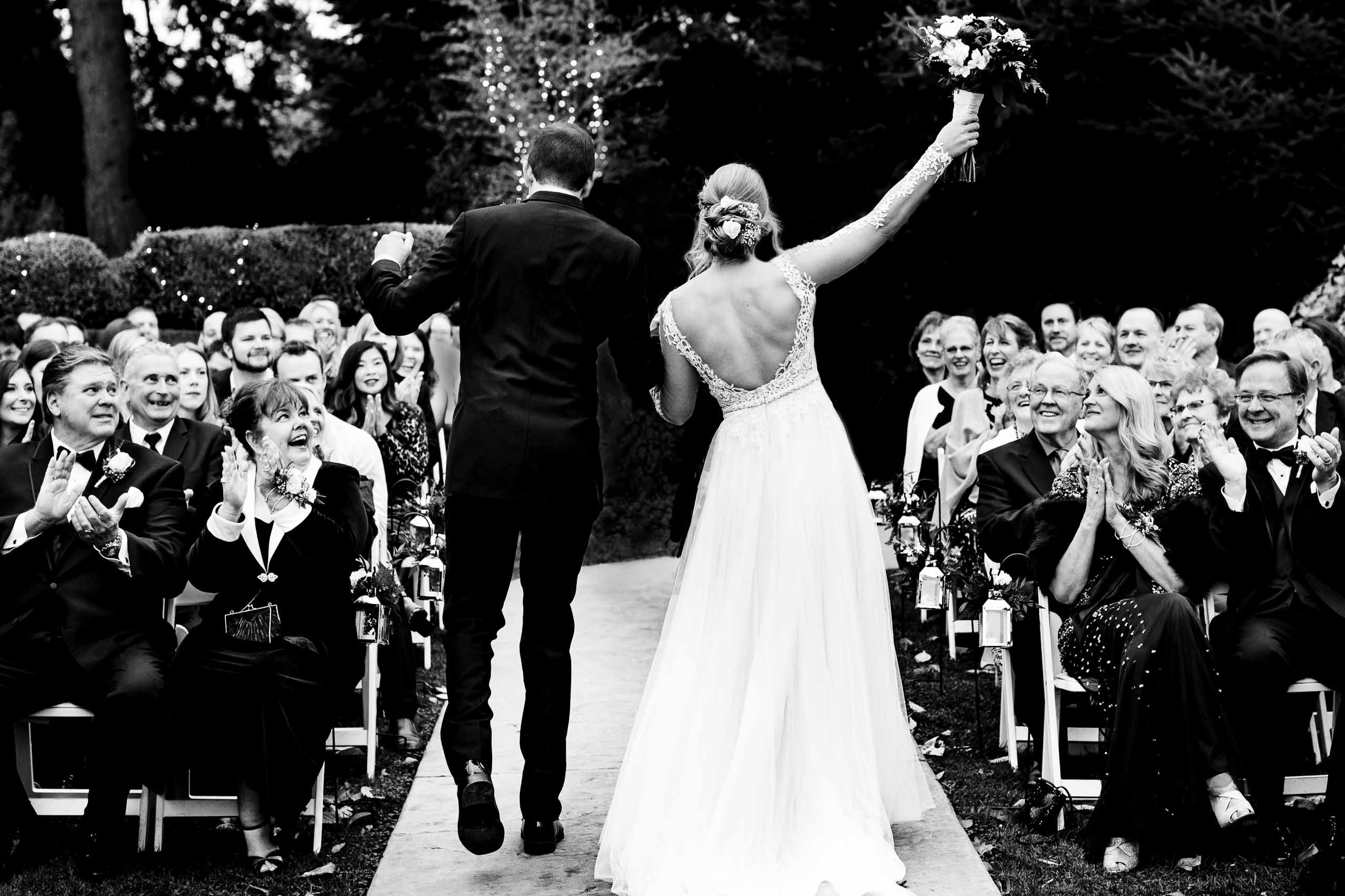 Bride and groom exiting and holding hands during their Columbia Gorge Wedding Ceremony in Hood River Oregon