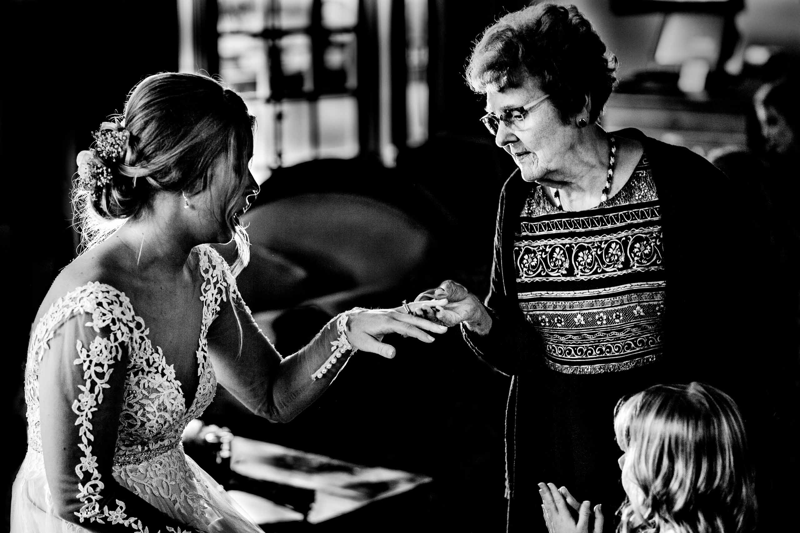 Grandmother looking at a brides ring just after her Columbia Gorge Hotel Wedding Ceremony