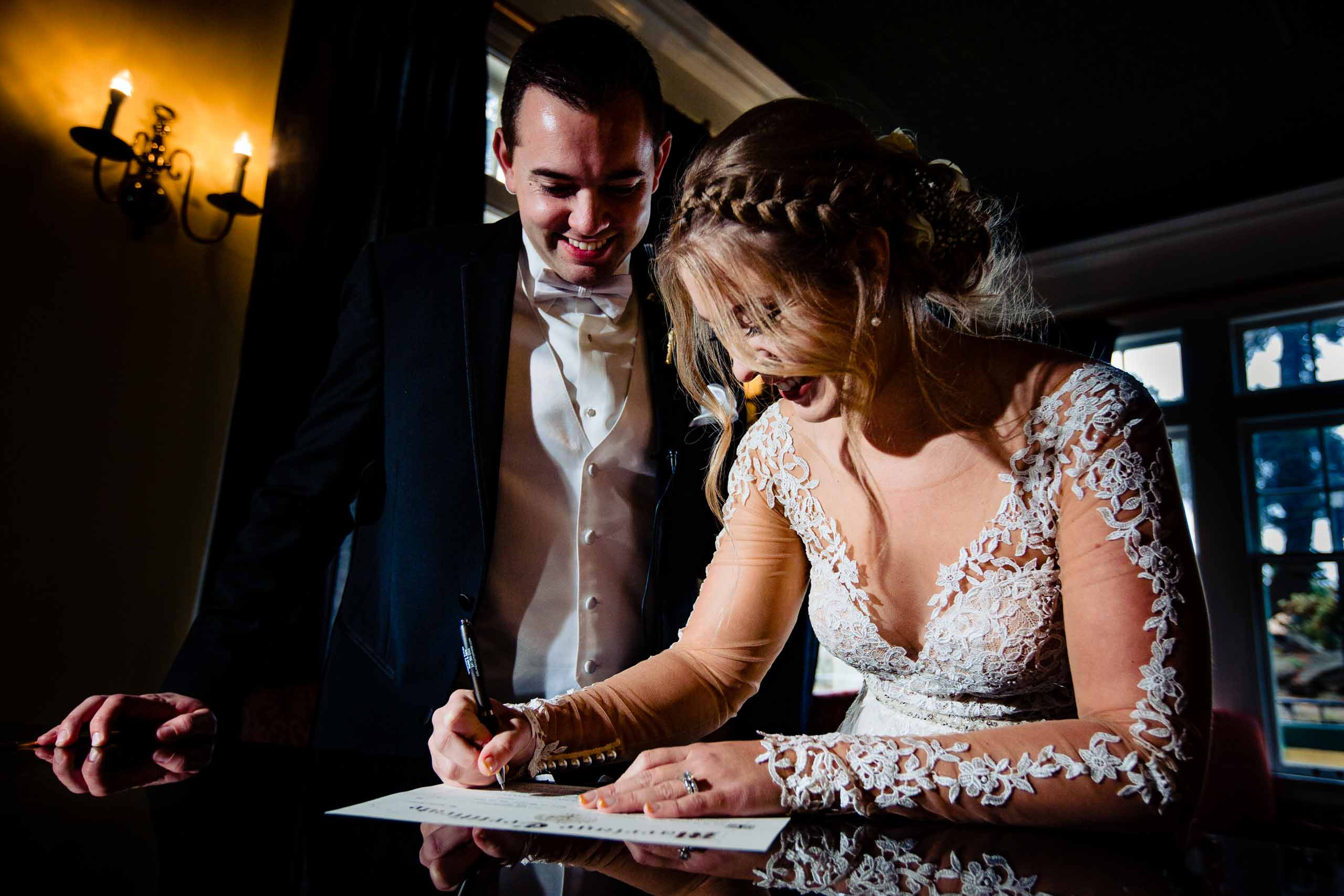 Bride and groom signing their wedding certificate moments after their Columbia Gorge Hotel wedding ceremony