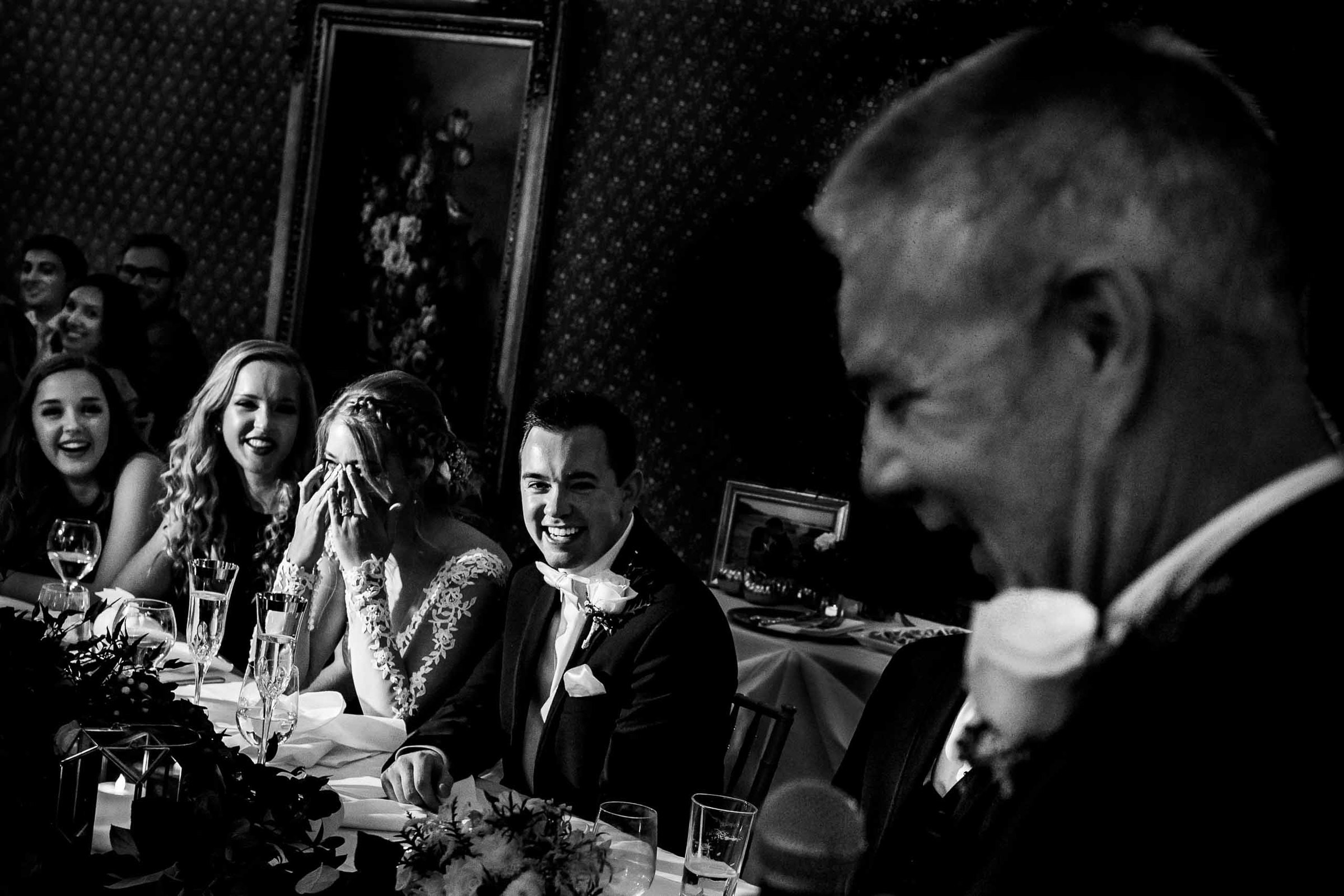 Bride and groom laughing with tears during a speech at their Columbia Gorge Hotel Wedding Reception