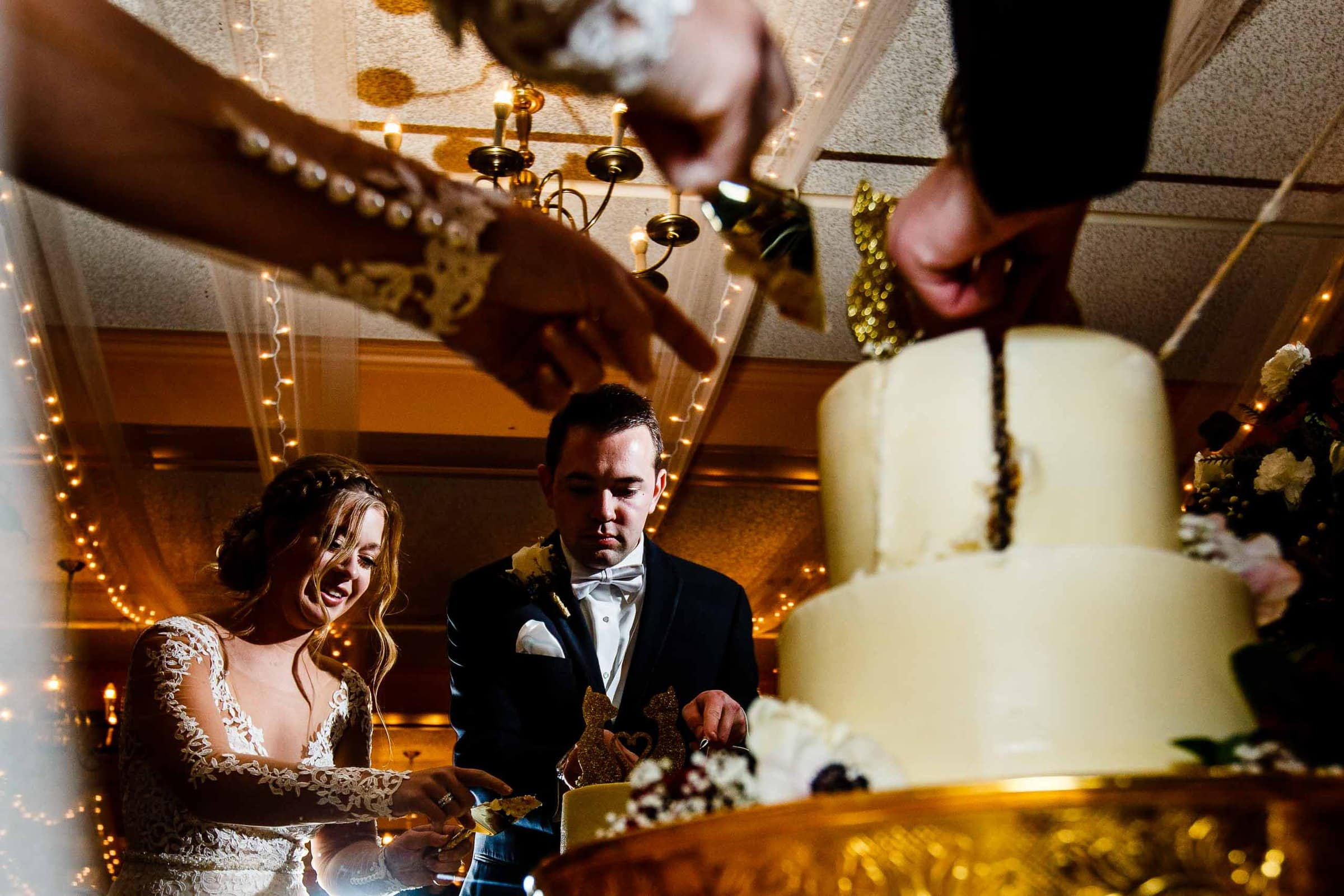 Bride and groom cutting their beautiful cake at their Columbia Gorge Hotel Wedding Reception