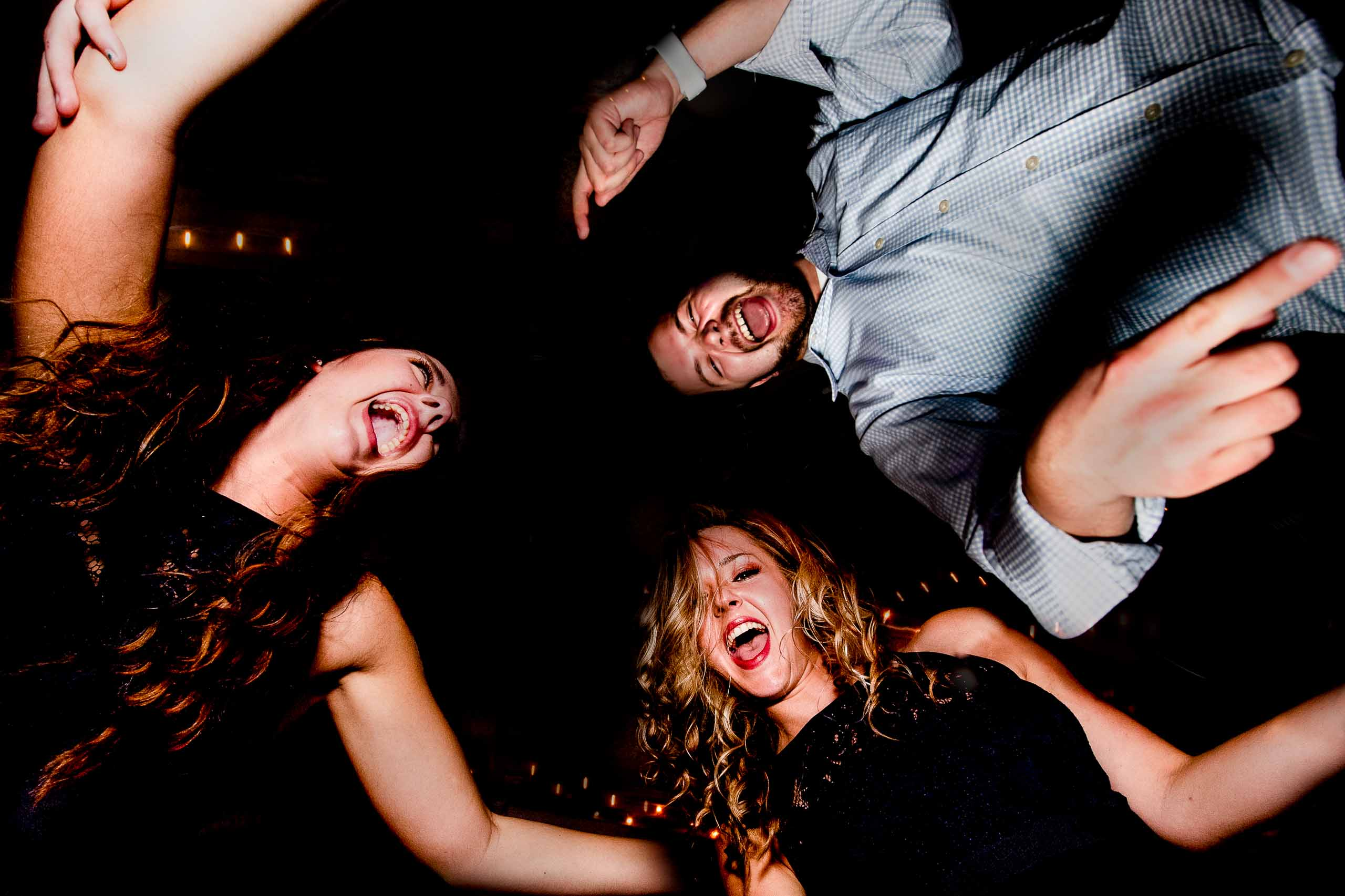 Fun photo of friends dancing at a Columbia Gorge Hotel wedding reception