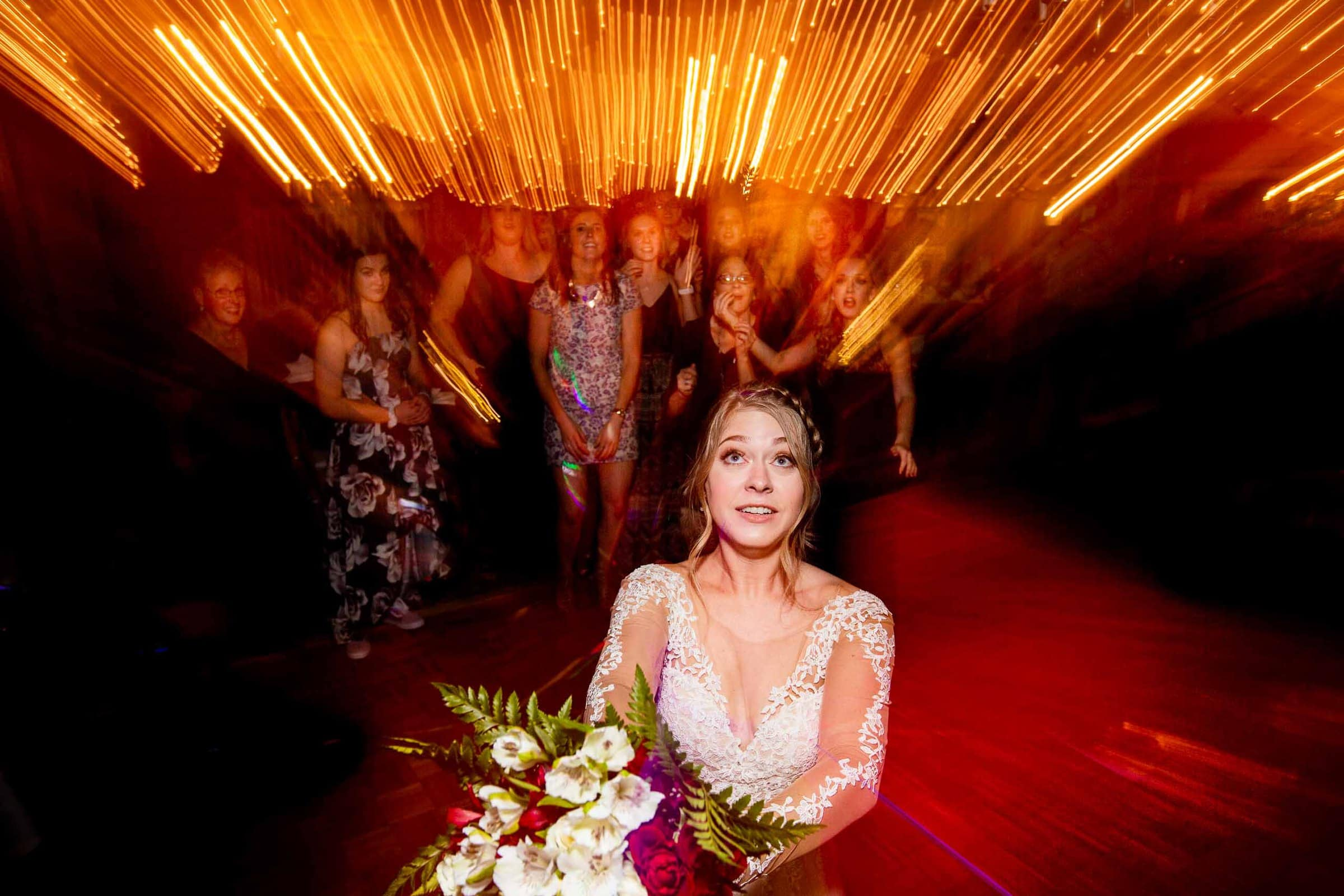 Abstract photo of a bride throwing her bouquet at her Columbia Gorge Hotel Wedding reception