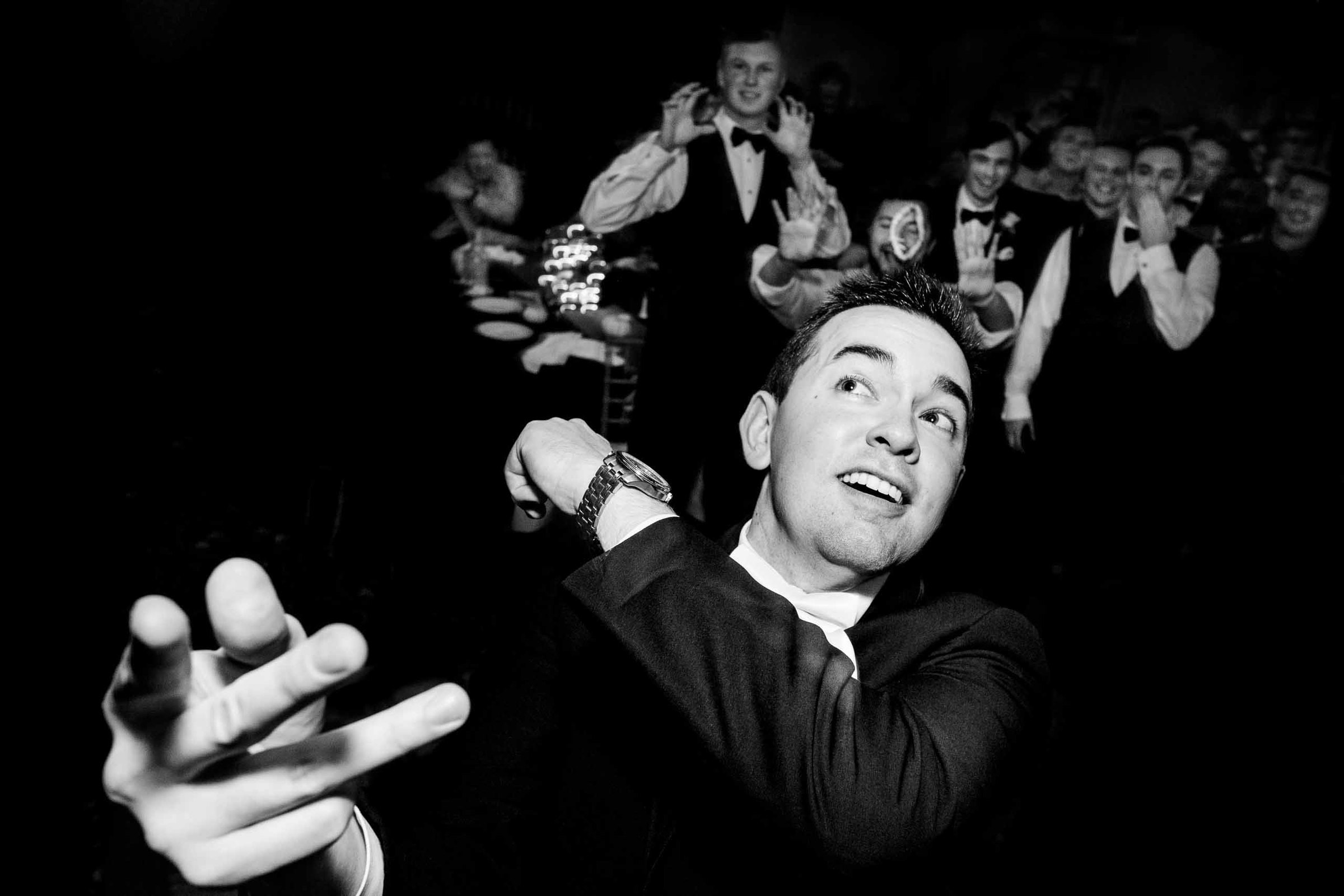 Groom throwing his buttoner to his friends at his Columbia Gorge Hotel Wedding reception