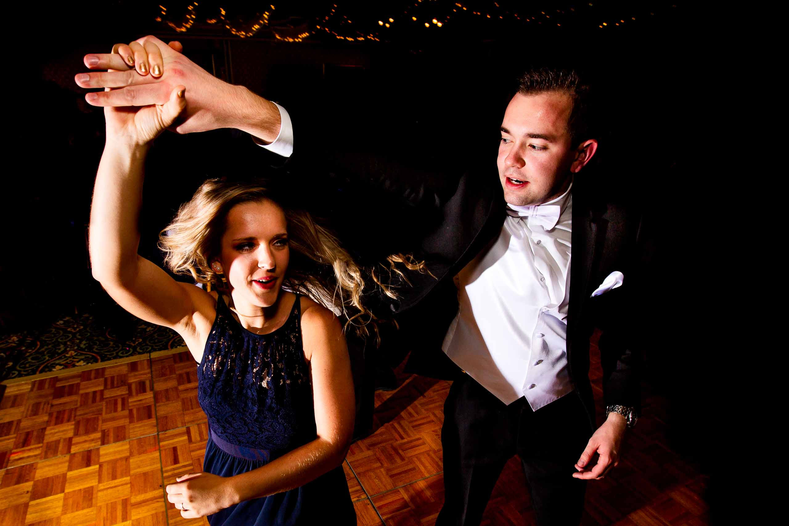Fun photo of a groom dancing with a friend at his Columbia Gorge Hotel wedding reception
