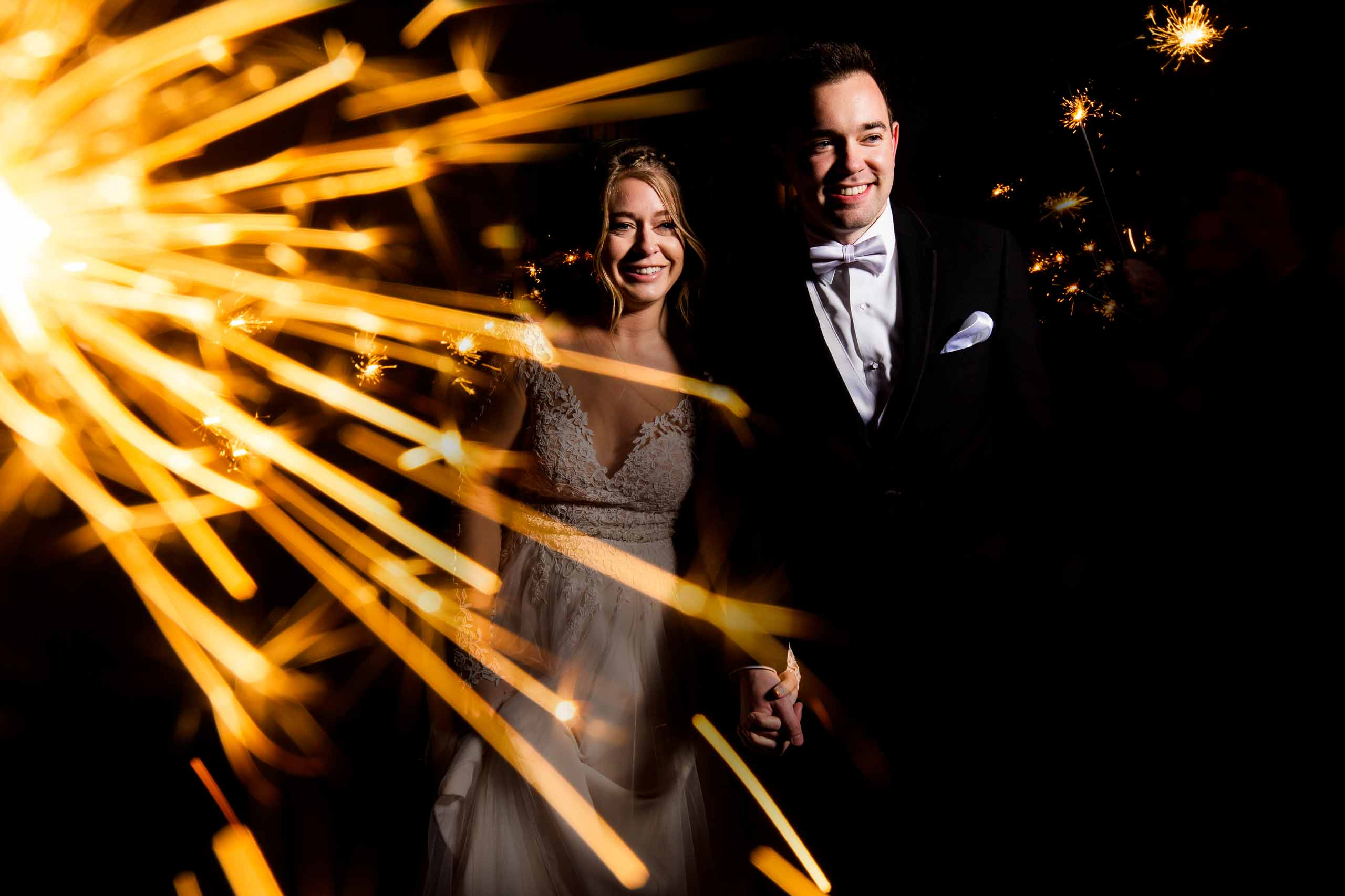 Fun photo of a bride and groom exiting during with sparklers at their Columbia Gorge Wedding reception