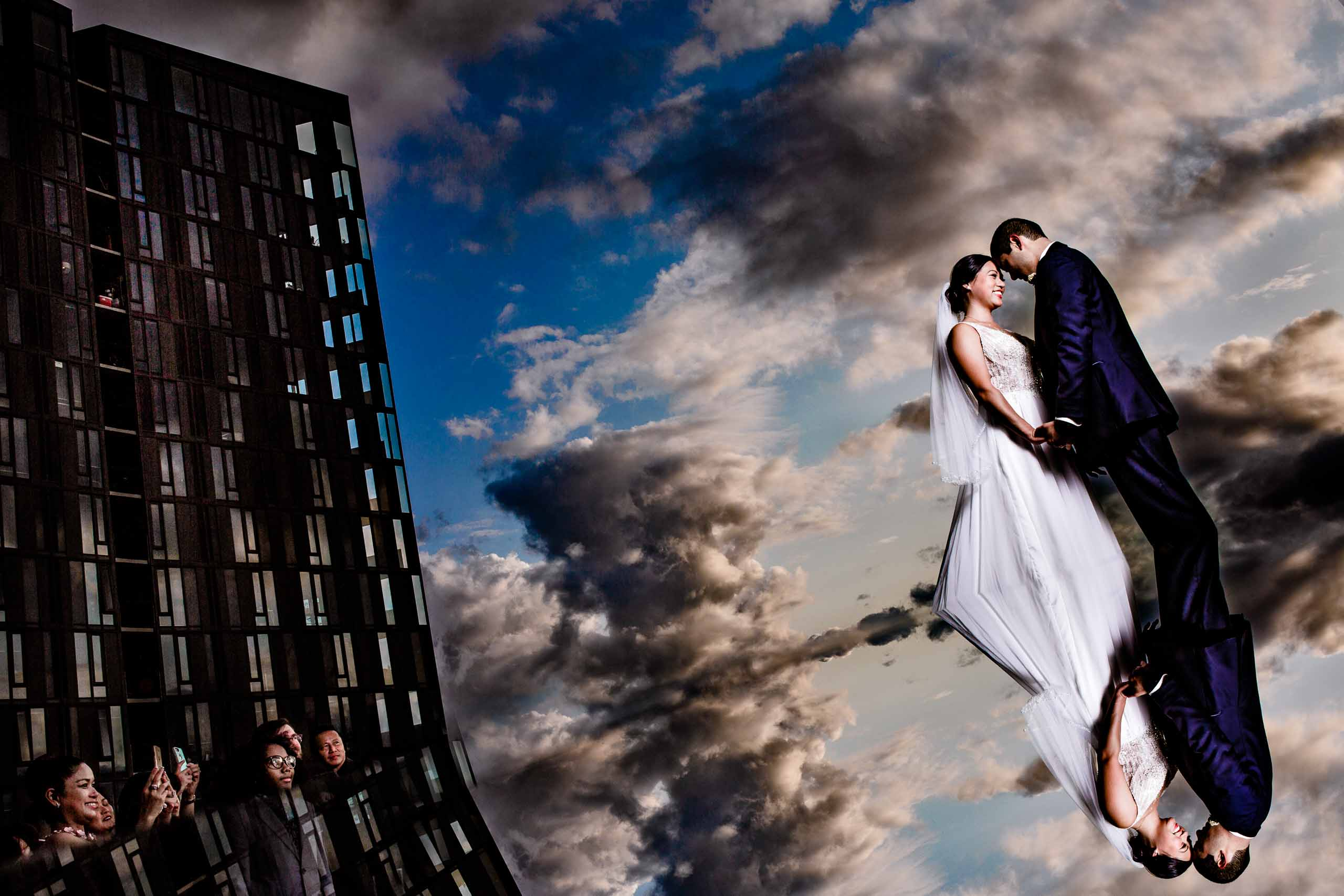 Creative portrait of bride and groom on Eastside Exchange Ballroom rooftop in Portland, Oregon