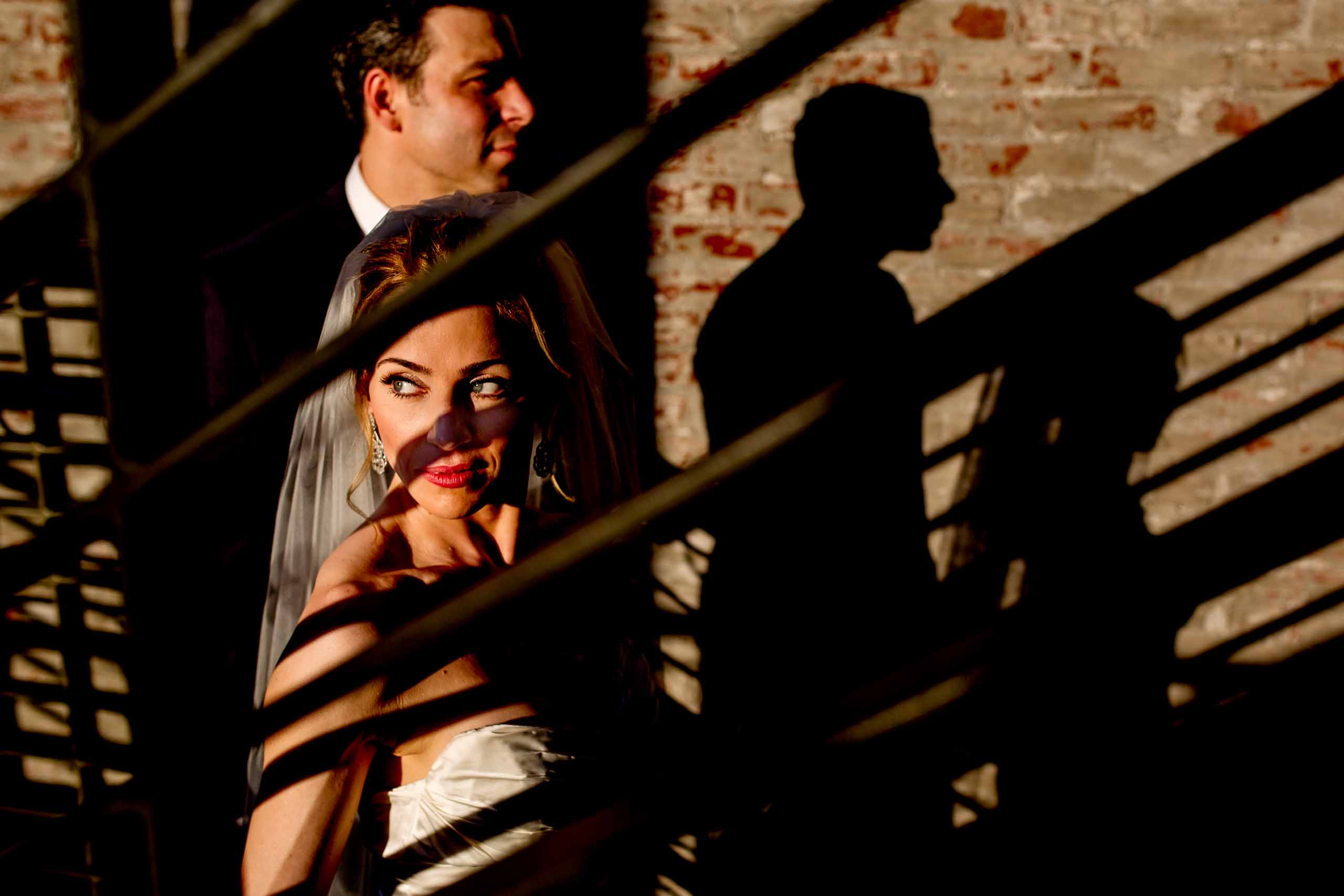 Dramatic light on bride and groom moments after their EcoTrust wedding ceremony in Portland, Oregon