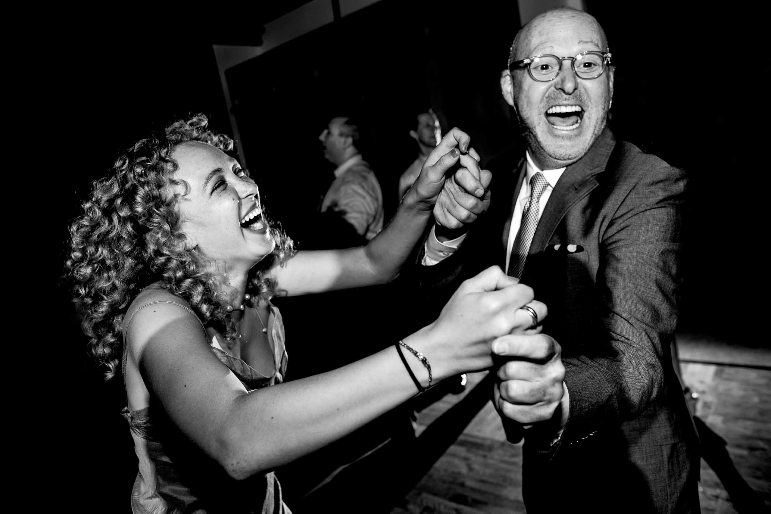 Friends and family having fun dancing at an EcoTrust wedding in Portland, Oregon