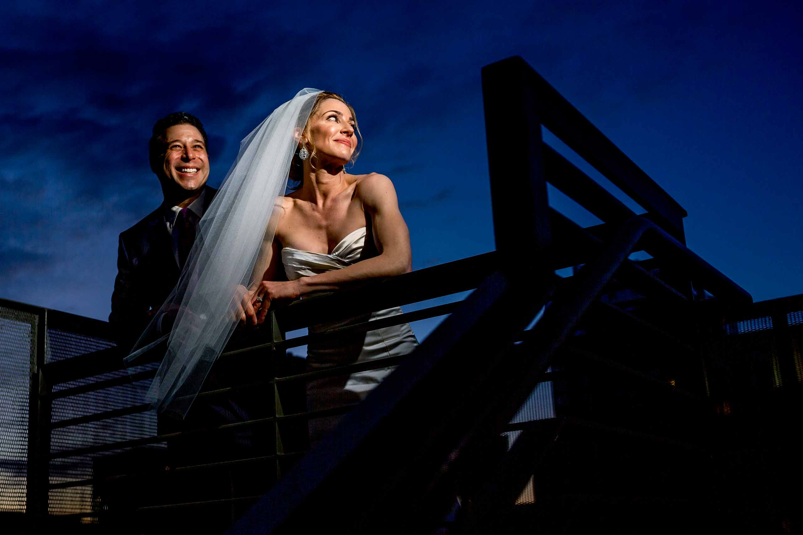 Bride and groom having fun at sunset at their EcoTrust wedding in Portland, Oregon