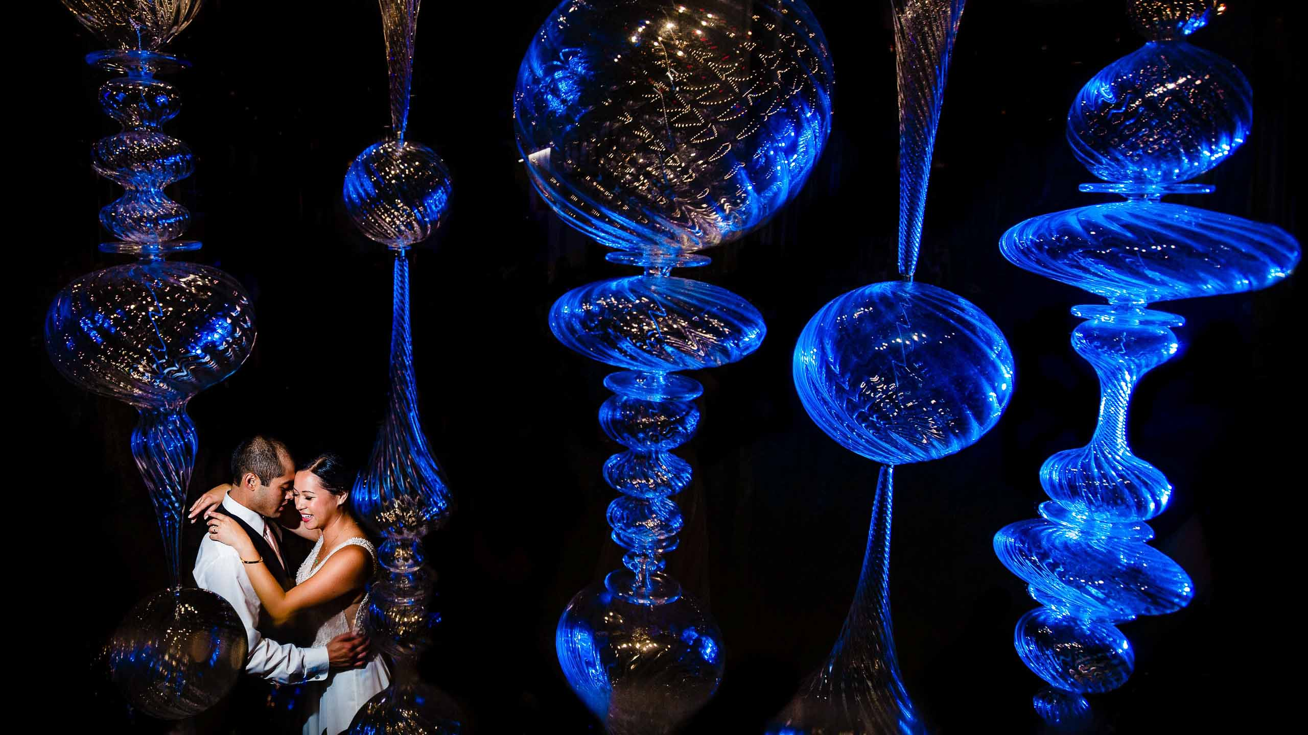 Creative photo of bride and groom with blue gels in crystal balls at Exchange Ballroom in Portland