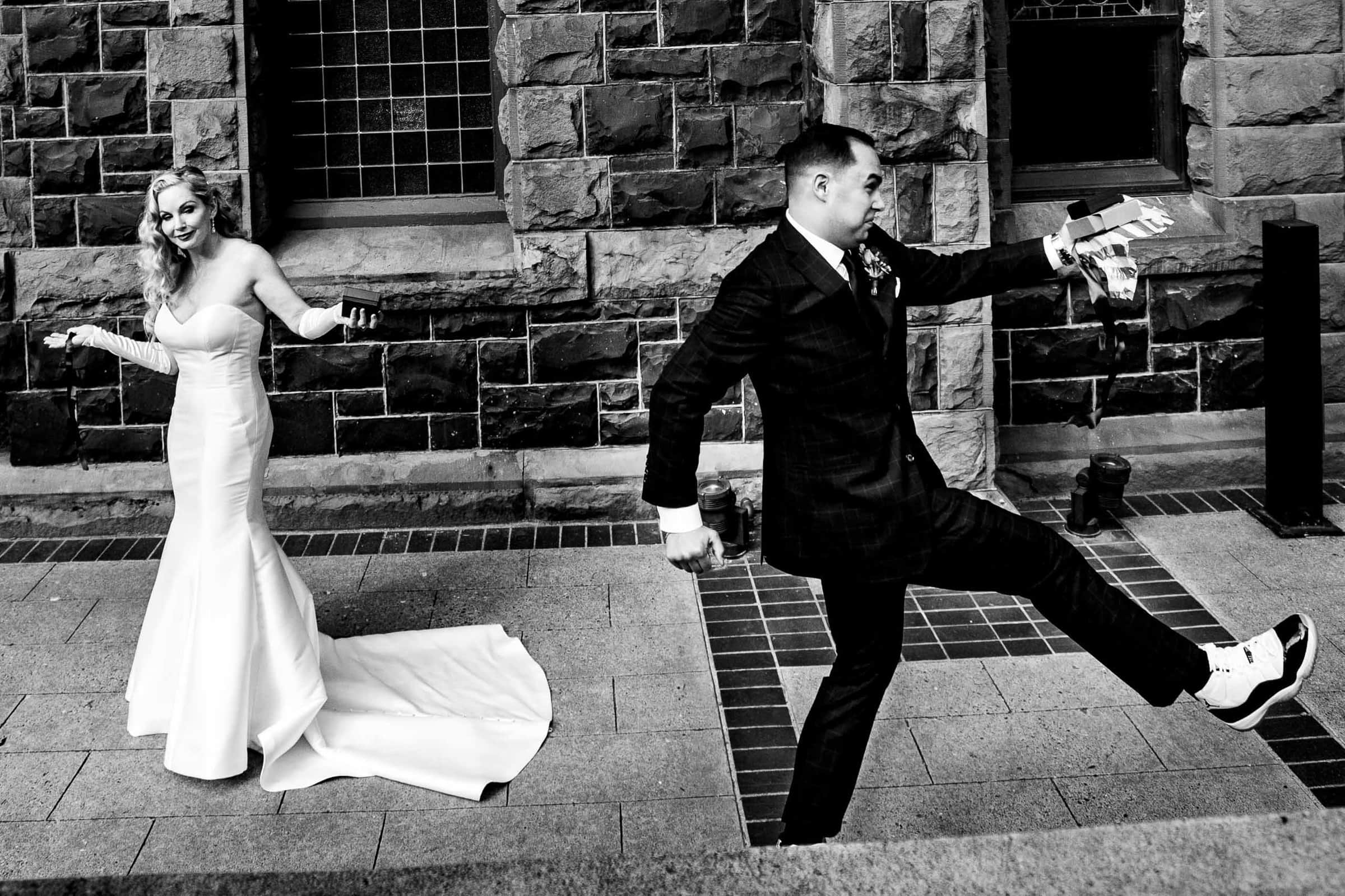 A comical photo of the bride and groom moments before their First Presbyterian Church Wedding in Portland Oregon