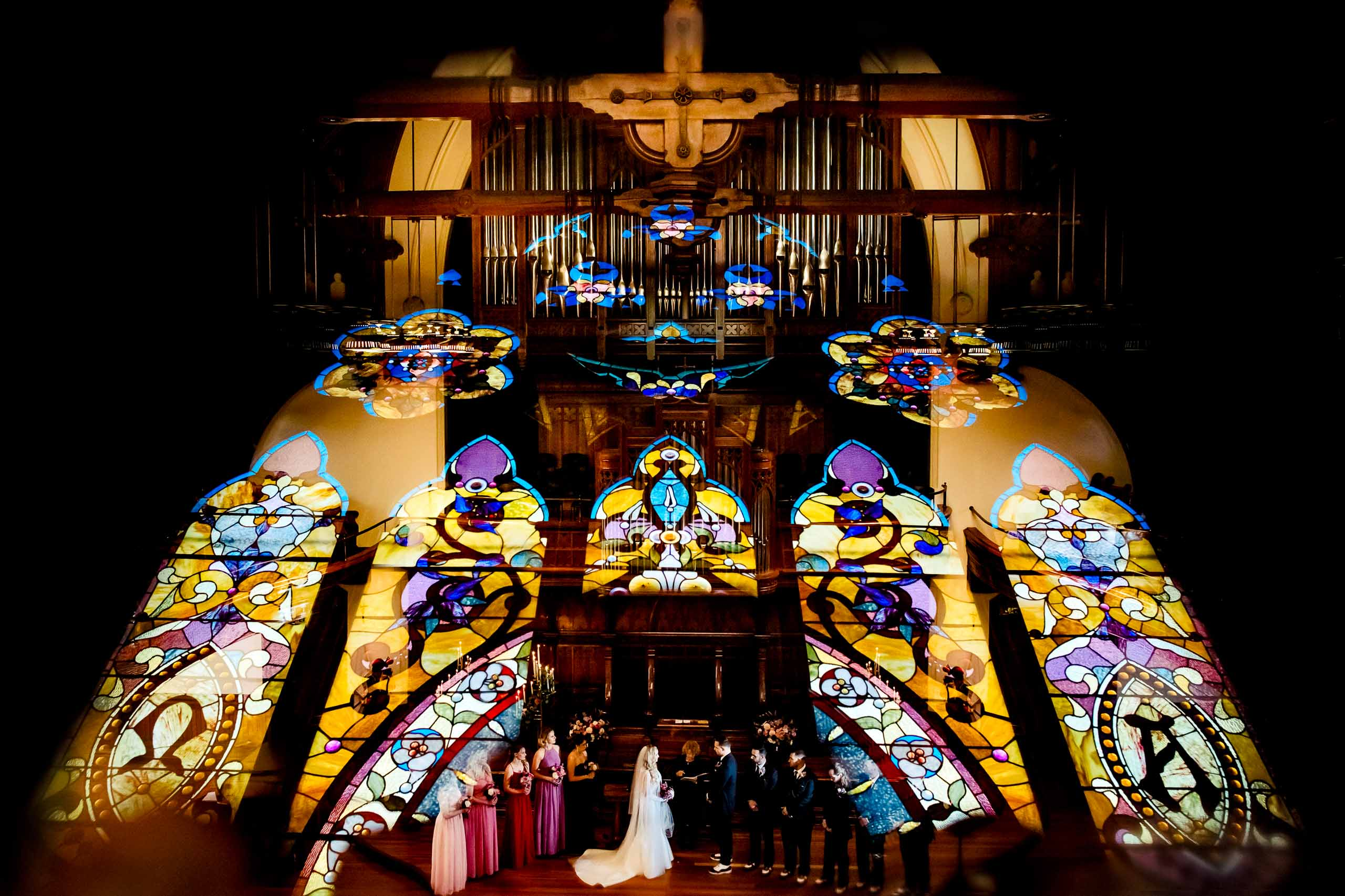 Extremely creative photo of a bride and groom with their bridal party in a First Presbyterian Church Wedding ceremony in Portland, Oregon