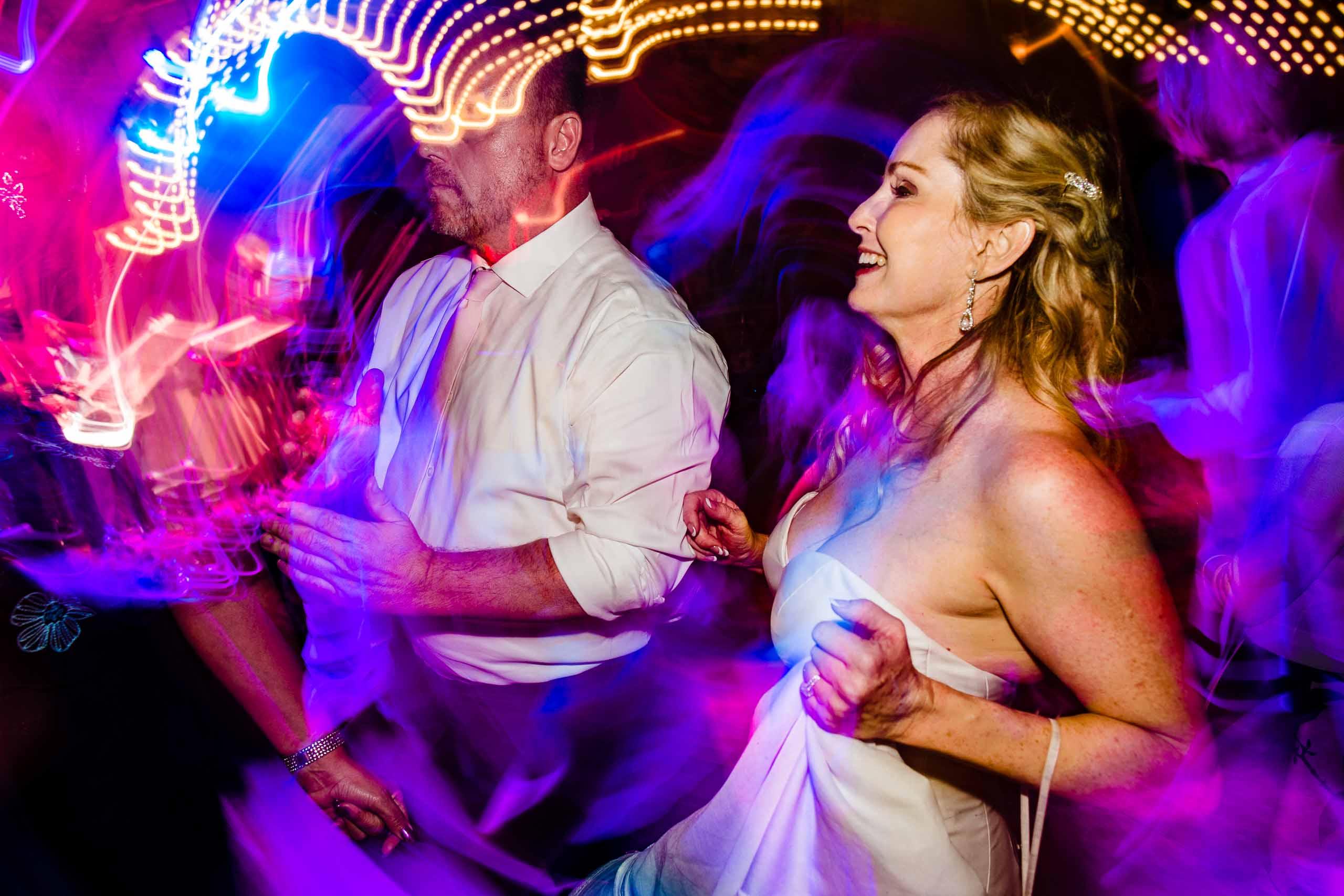 Crazy fun dance photo of a bride at a First Presbyterian Church Wedding Reception at the Crystal Ballroom in Portland, Oregon