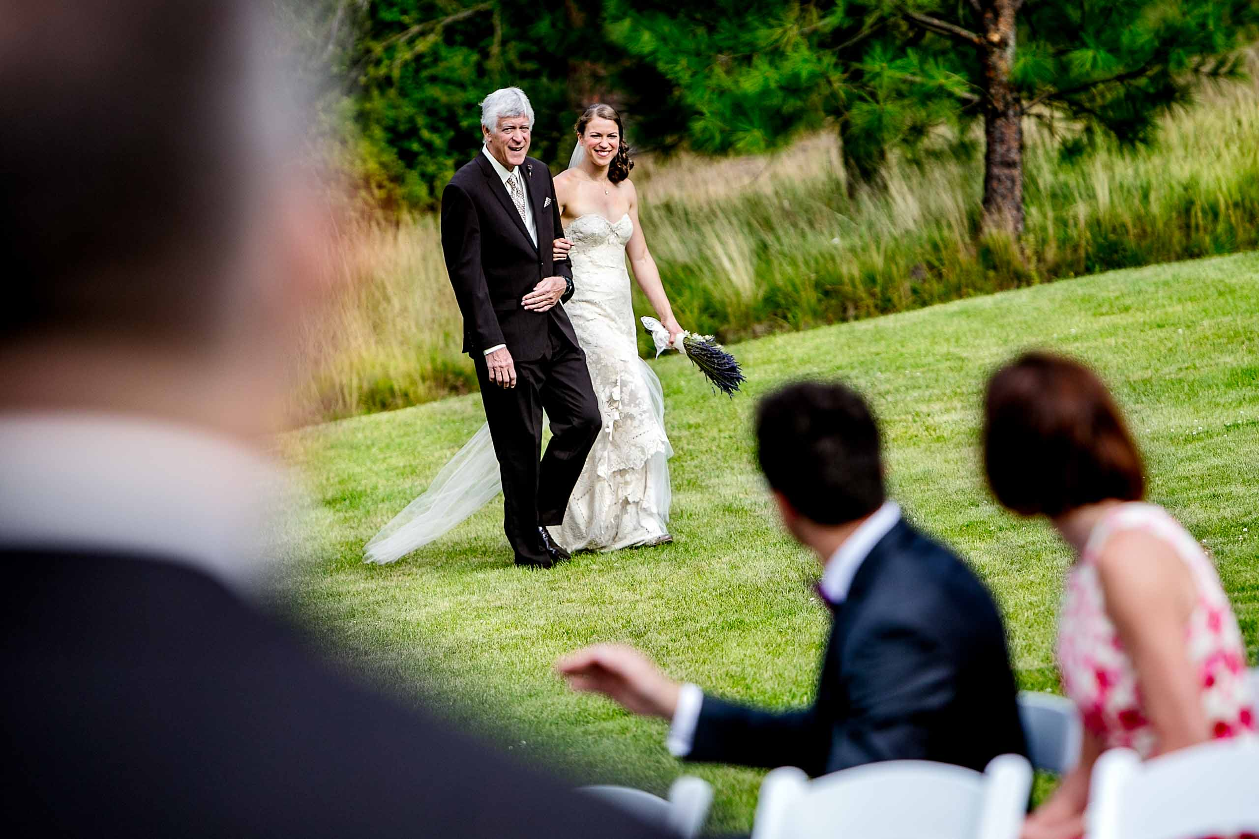 Bride walking with her father into her House on Metolius wedding ceremony
